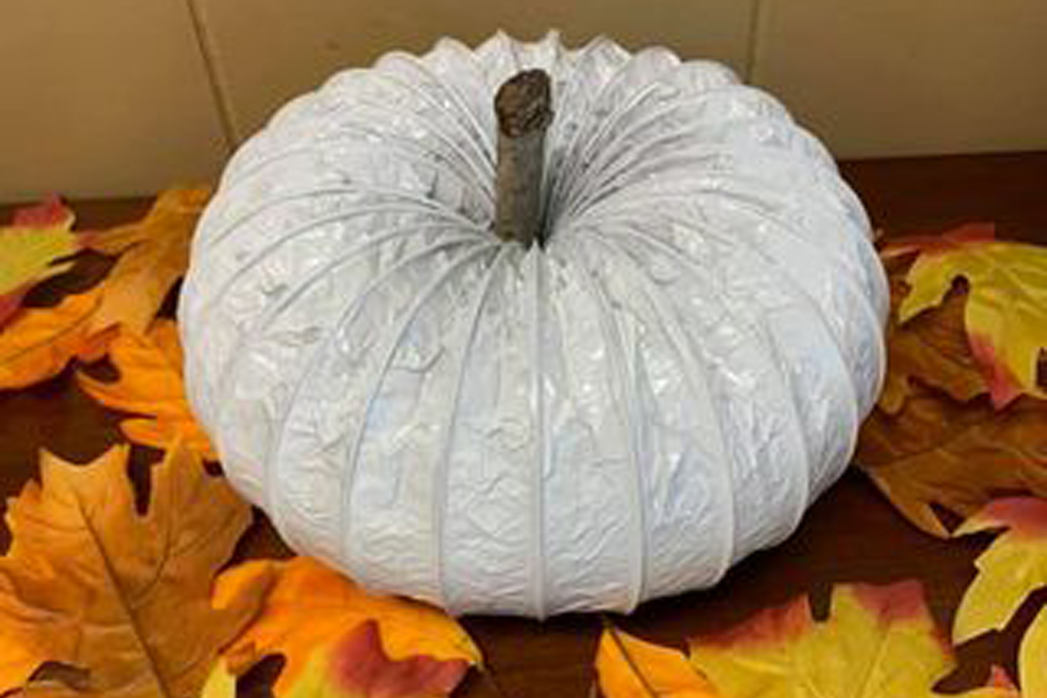 A pumpkin made from a drier vent.