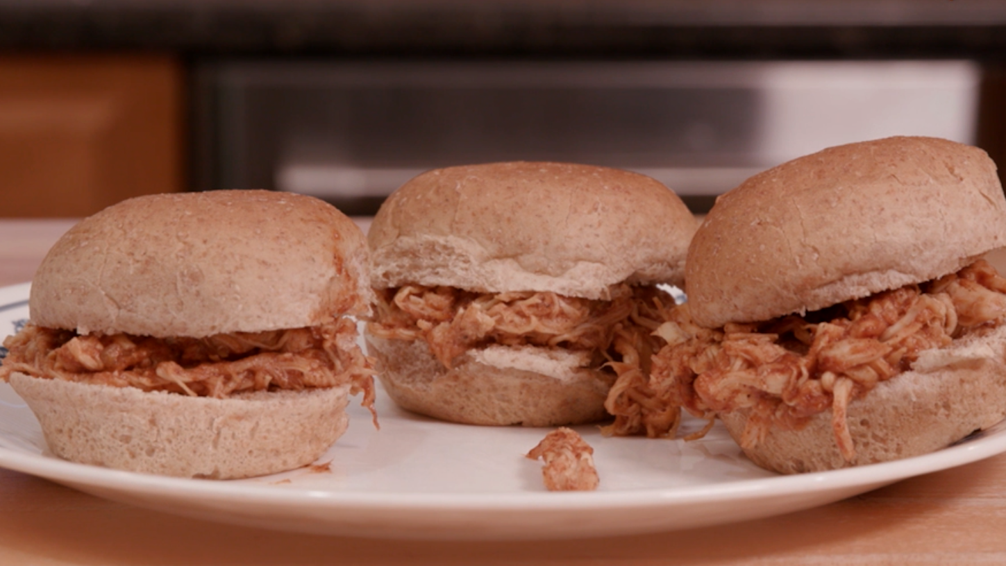 Barbecue chicken sliders on wheat buns