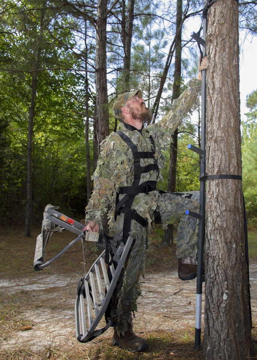 Many falls from tree stands occur when hunters are climbing to a stand or when they are coming down. The majority of hunters fail to wear fall restraint systems during this critical time. (Illustrated photo by MSU Extension Service/Kevin Hudson)