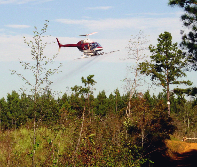 Figure 4. (right) Aerial application of herbicide to control unwanted vegetation in site preparation.