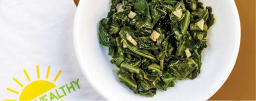 A bowl of cooked greens.