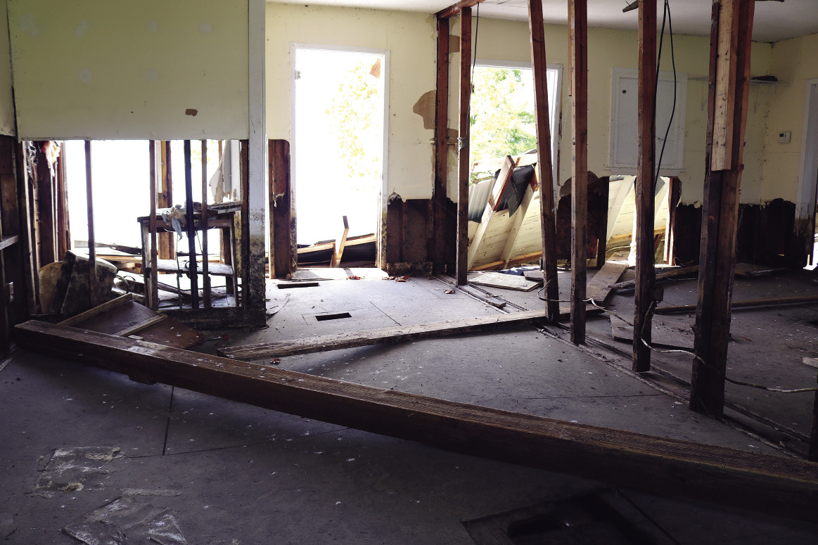 The interior of a house with severe damage from flooding.