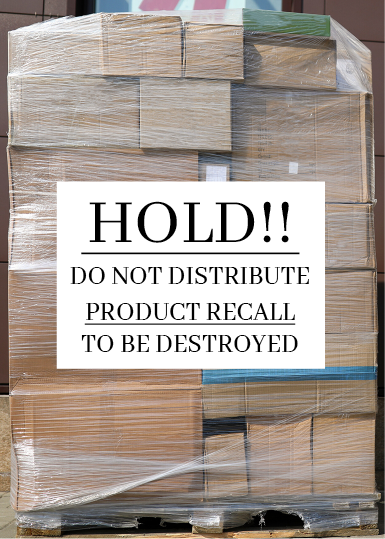 "A stack of cardboard boxes on a pallet. All of the boxes are shrinkwrapped together, and a sign attached to the stack reads ""Hold!! Do not distribute. Product recall. To be destroyed."