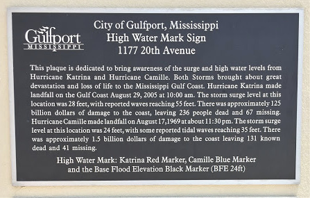 A plaque with information on the impacts of Hurricanes Camille and Katrina to the Mississippi Gulf Coast.