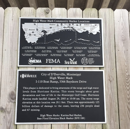 Two plaques with information on the High Water Mark Initiative and the impacts of Hurricanes Camille and Katrina to the Mississippi Gulf Coast.