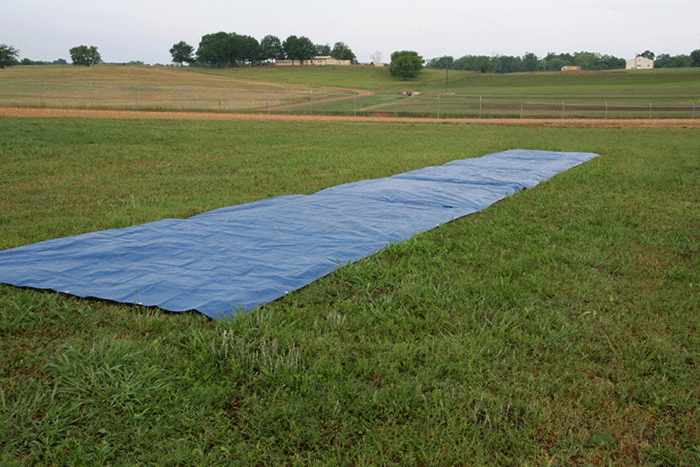 This is an image of a tarp placed on a field to use in calibrating poultry litter spreading equipment.