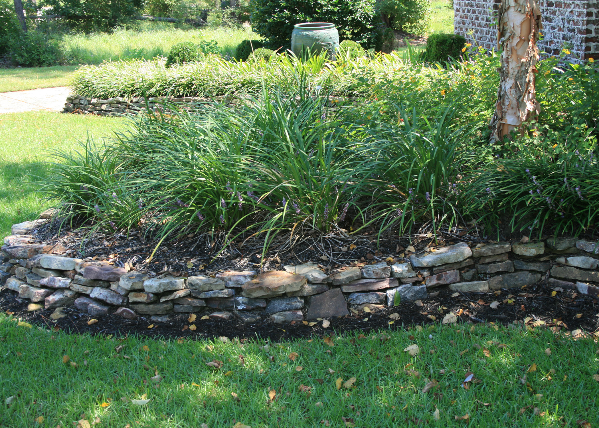 Raised beds make gardening easier mississippi state for Decorative stone garden border