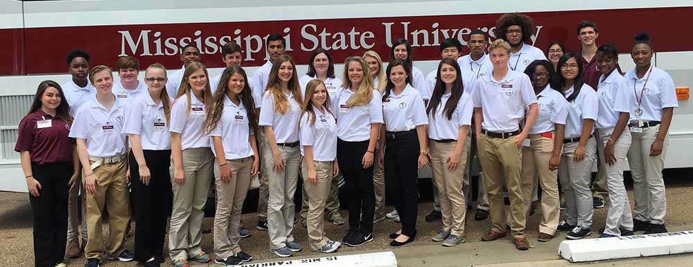 2016 group of Rural Medical Scholars in front of MSU bus.