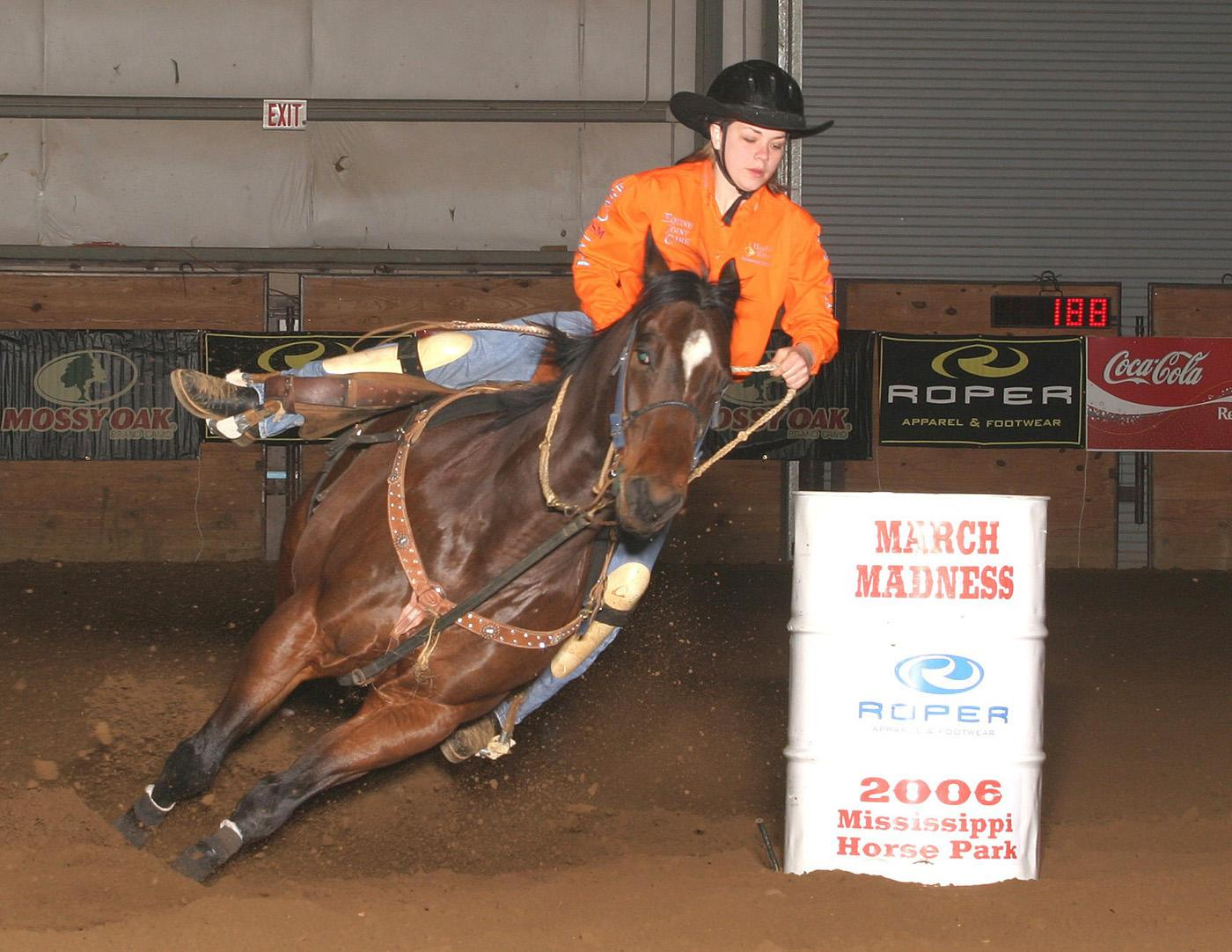 Kass Downen, an 11th grader from Illinois, makes a turn around a barrel at the March Madness Barrel Race held this spring at the Mississippi Horse Park in Starkville. Downen was this year's average champion and won $3,585 with four runs totaling less than a minute.