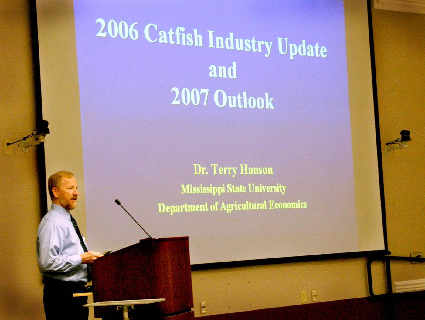 Mississippi State University agricultural economist Terry Hanson speaks at the National Warmwater Aquaculture Center's Fall 2006 catfish seminar held recently at MSU's Delta Research and Extension Center in Stoneville. Hanson told the crowd that rising corn demand will lead to even higher catfish feed prices for farmers in the coming year. (Photo by Robert H. Wells/Delta Research and Extension Center)