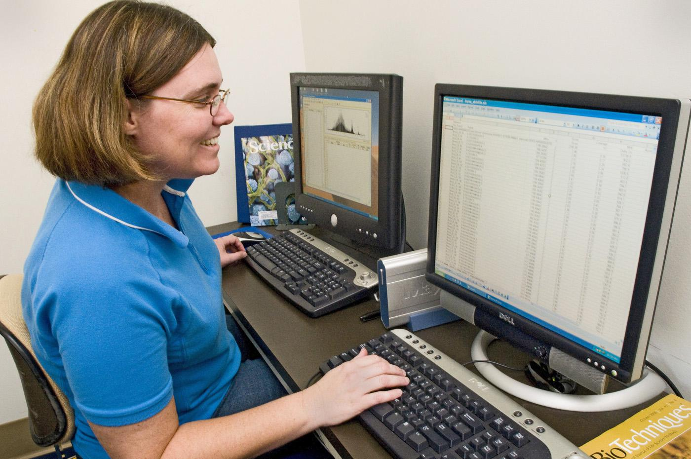 Fiona McCarthy, a biocuration specialist with the Mississippi State University College of Veterinary Medicine, examines protein expression data that may indicate how the immune system develops in chickens. (Photo by Tom Thompson)