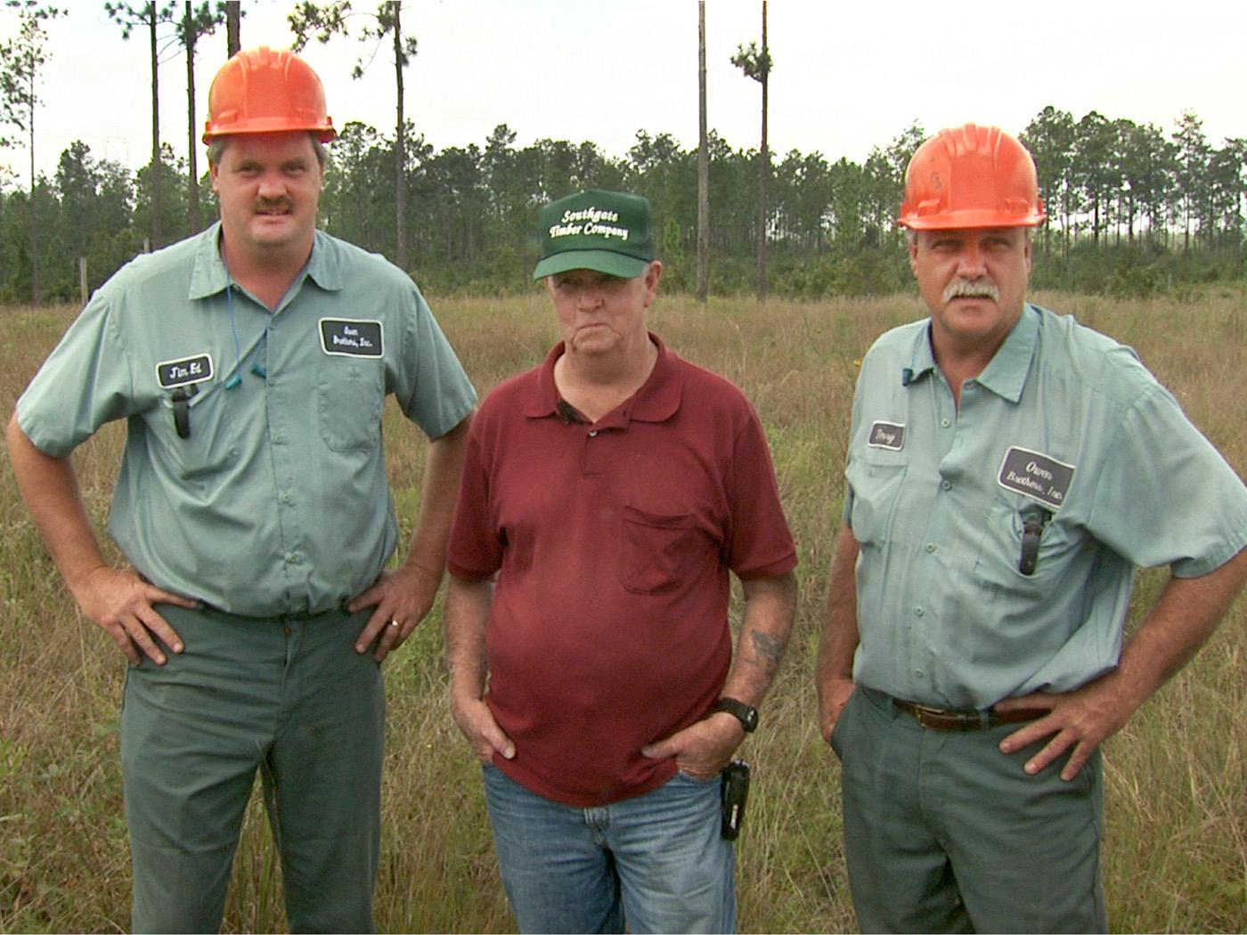 Jim Ed Owen, left, and Terry Owen, far right, of Wiggins, learned the craft of logging and the importance of stewardship from their father, Walt. The brothers have operated their own business for more than 11 years. (Photo bb Leighton Spann)