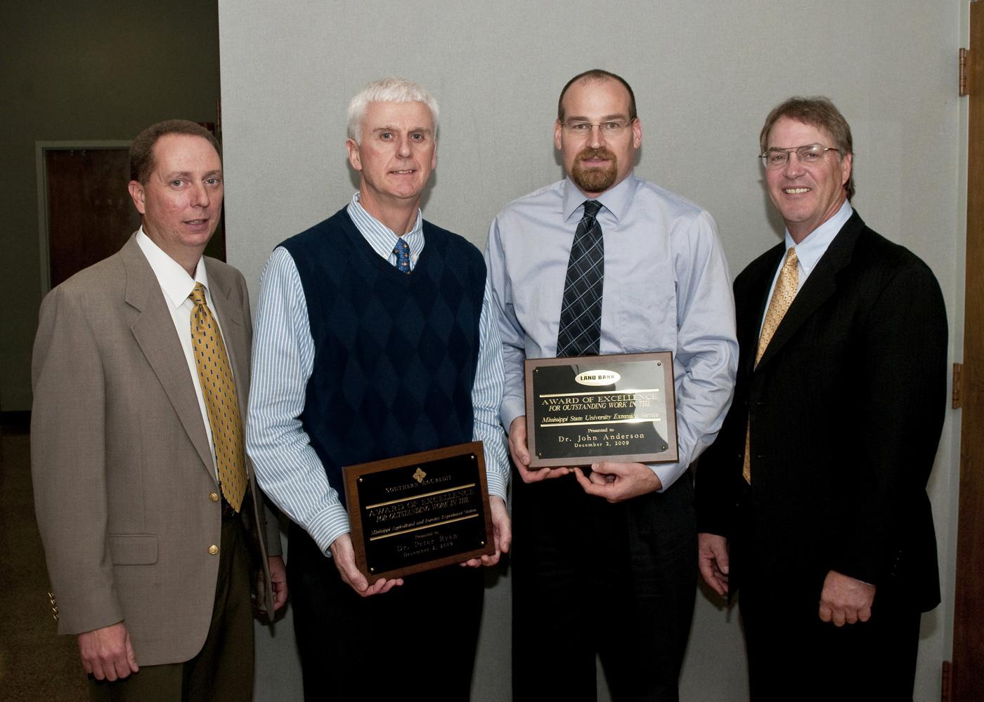Two Mississippi State University agricultural division employees were recently honored for service and career achievement. From left are award sponsor representative Michael Barnes of Southern Ag Credit; Peter Ryan, recipient of the 2009 MAFES Excellence in Research Award; John Anderson, recipient of the 2009 Outstanding Extension Worker Award; and award sponsor representative Bill Cook of the Land Bank of North Mississippi. (Photo by Scott Corey)