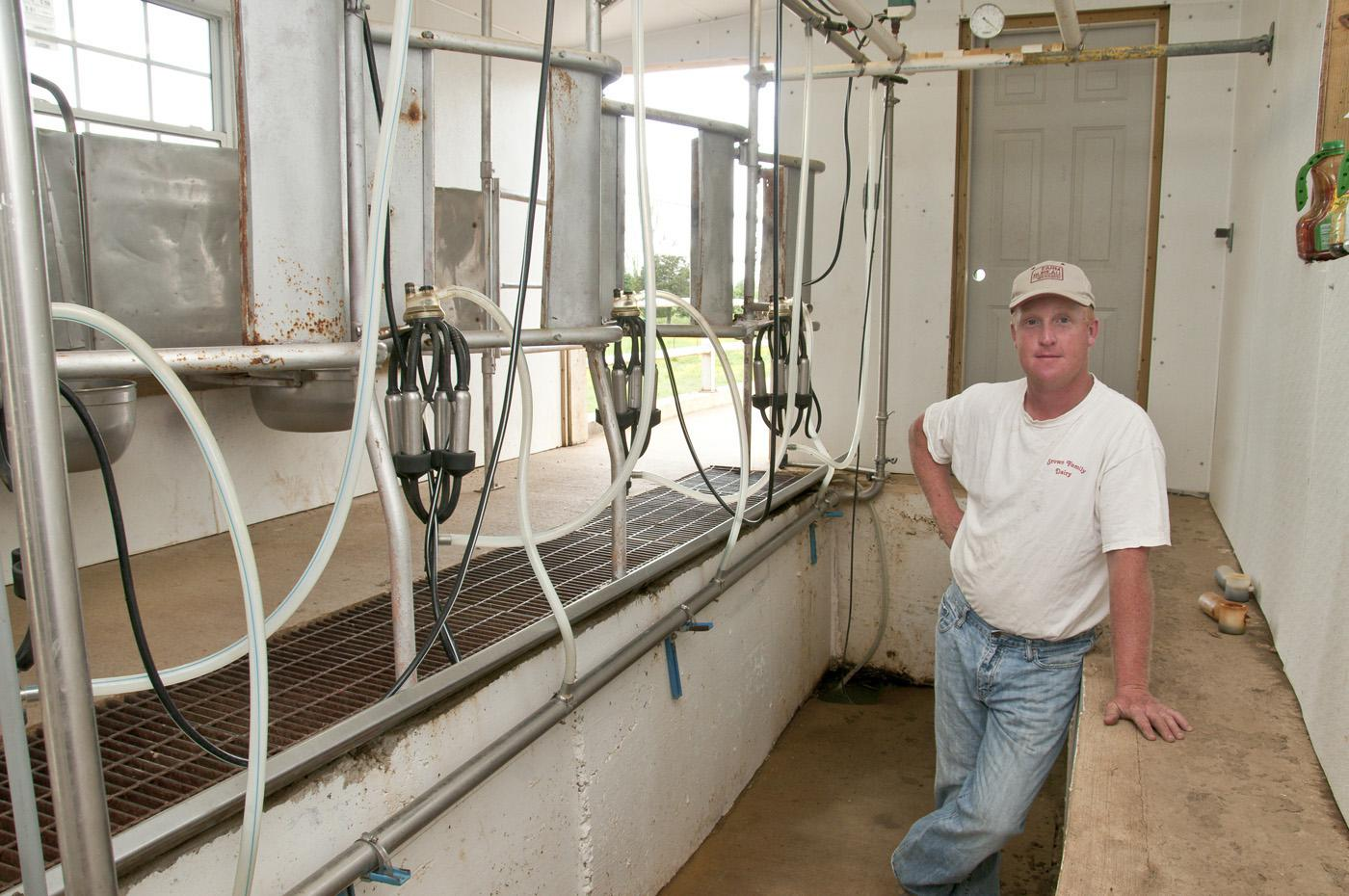Billy Ray Brown stands on the lower level of the milking parlor he built for his Jersey cows. (Photo by Scott Corey)