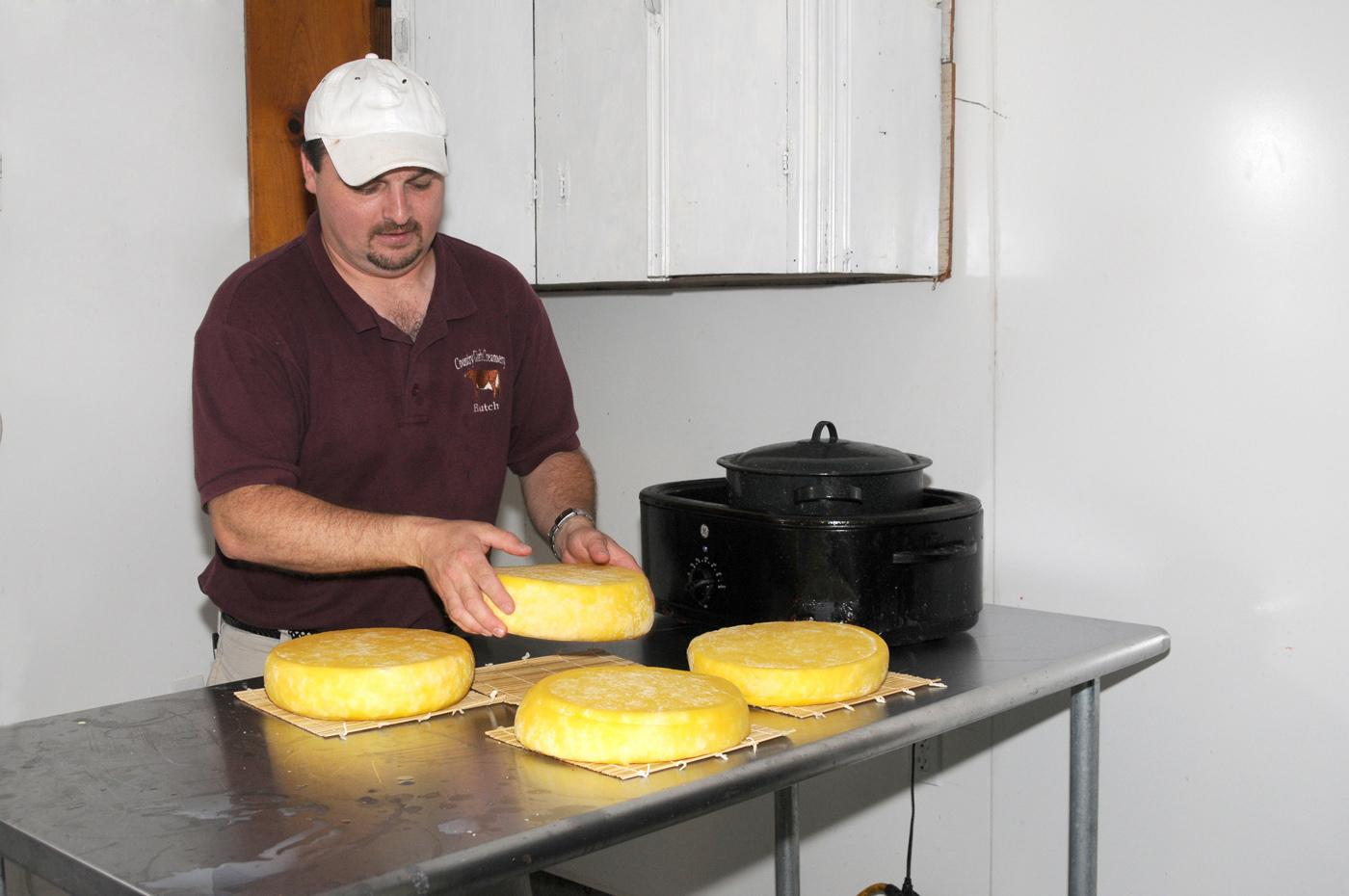 Butch Smith prepares to package cheese produced from Jersey cow milk on his family farm. (Photo by Kat Lawrence)
