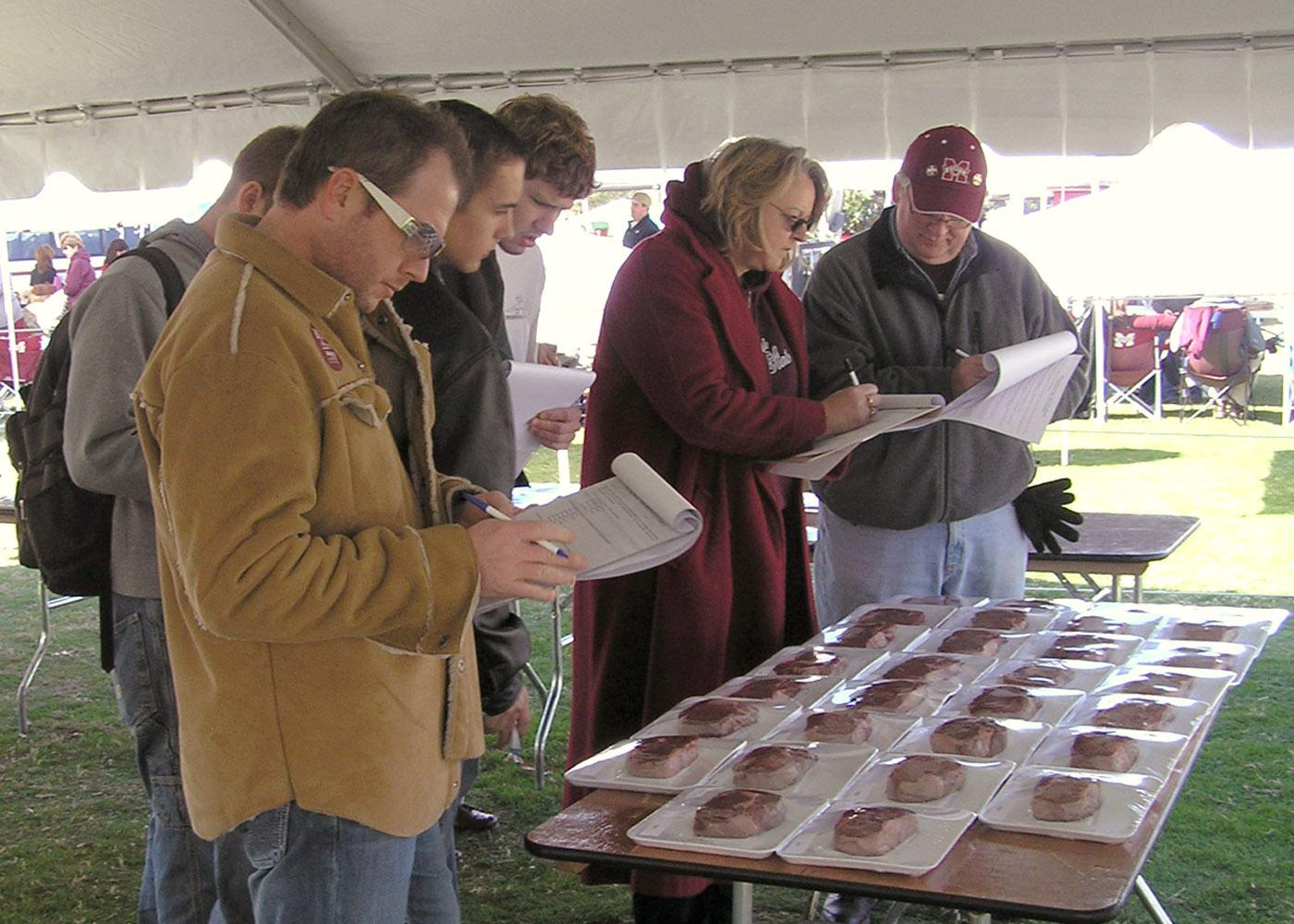 Participants in a Mississippi Agricultural and Forestry Experiment Station research project rate steaks displayed in Mississippi State University's Junction. The research team was gauging the public's willingness to pay extra for a thicker, heartier steak. (Photo by MSU Food Science, Nutrition and Health Promotion/Jason Behrends)