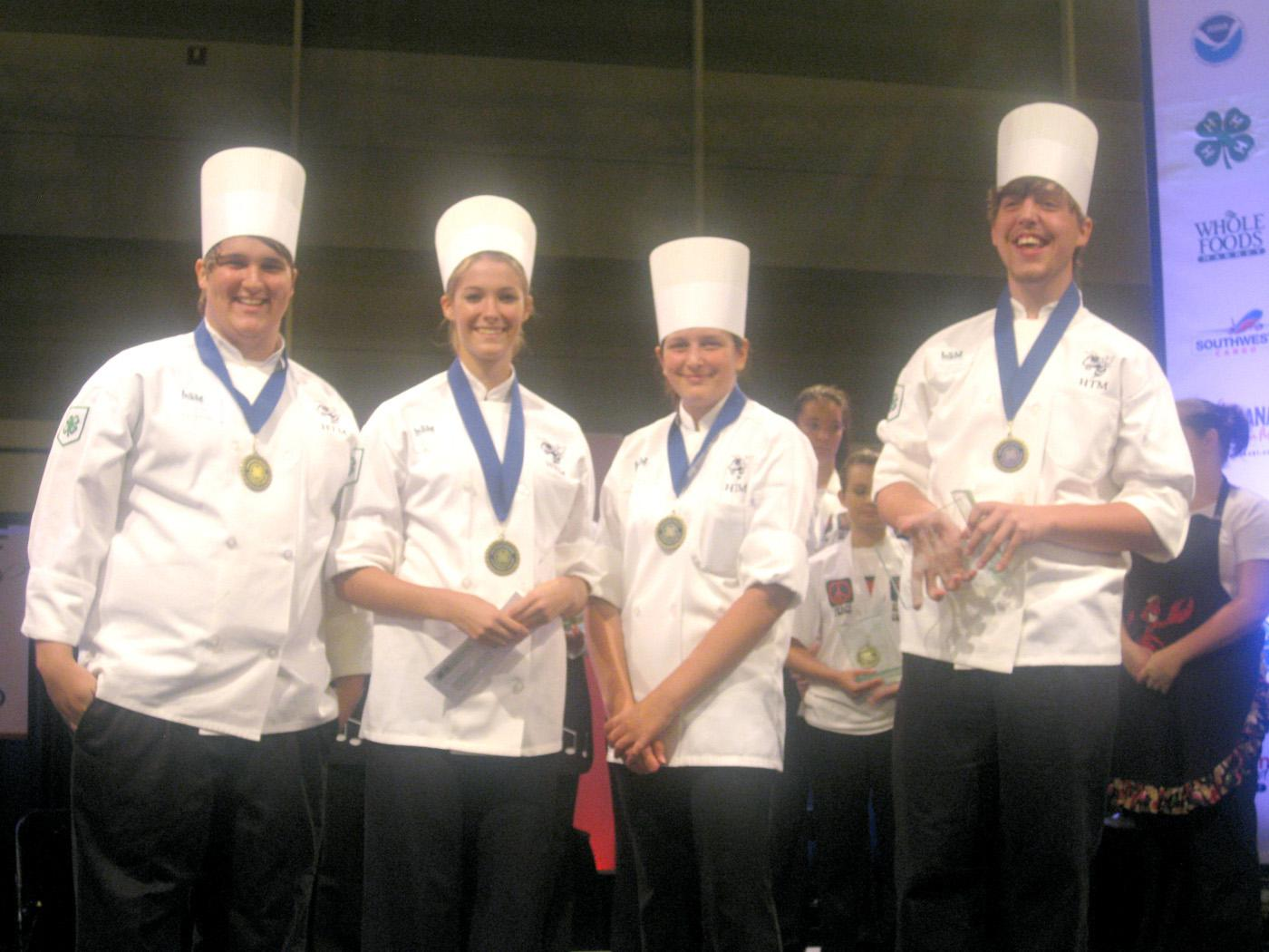 The Jackson County 4-H team of chefs from St. Martin High School (from left), Cory Martin, Sarah Soares, Adriana Wilson, and Jarod Harris, were named grand champions of the first-ever Southern Regional 4-H Seafood Cook-Off, held in conjunction with the Great American Seafood Cook-Off in New Orleans. (Submitted photo.)