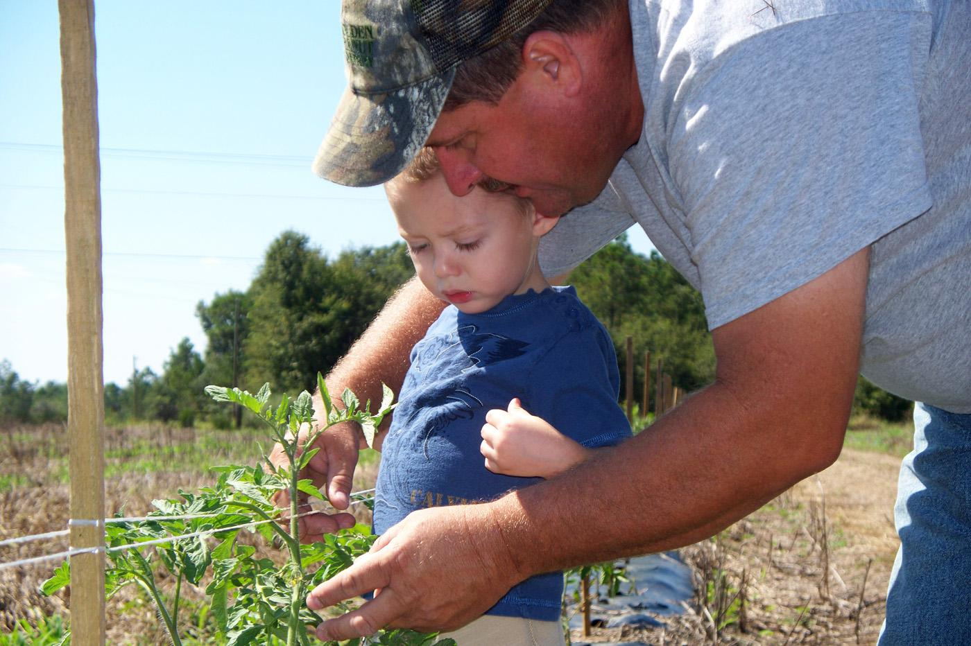 Mike Steede, pictured with his nephew Gunter, and his family operate a community supported agriculture program on land their family has farmed for over a century.