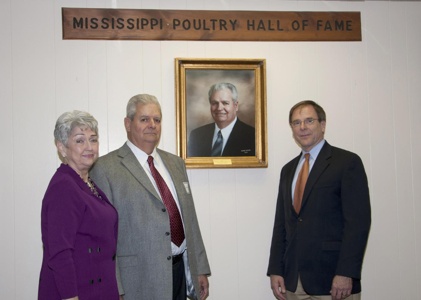 "Coyt ""Bud"" West was inducted into the Mississippi Poultry Association's Hall of Fame for his many years of dedication to the poultry industry. West was joined by his wife, Gwen (left), and Mississippi Poultry Association President Mark Leggett (far right) at the Nov. 17 event. (Photo by Kat Lawrence)"
