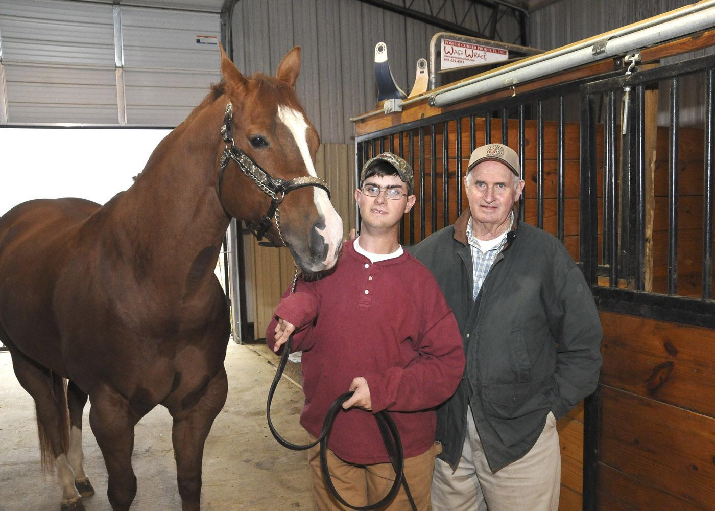 After multiple surgeries and extensive physical therapy for cerebral palsy, Jamie Mangum, pictured with his horse Bubba and grandfather James Roy Hawkins, shows halter horses without assistance. (Photo by Scott Corey)