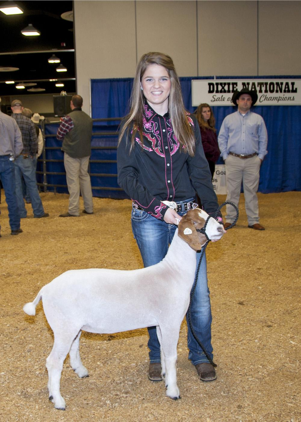 Alexandra Pittman of Forrest County 4-H set a record with her reserve champion medium weight goat, which brought $100 per pound. (Photo by Kat Lawrence)
