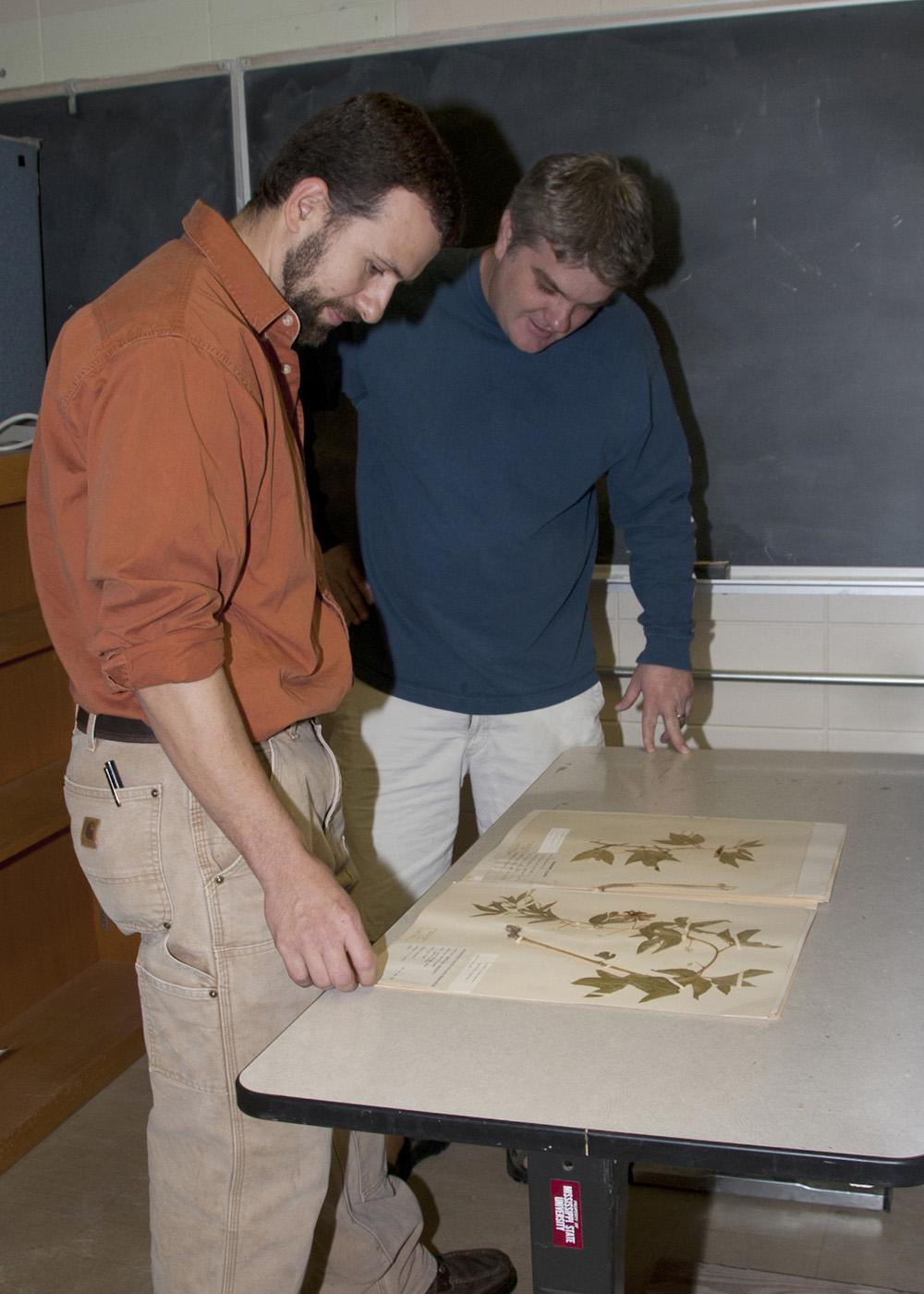 JoVonn Hill, left, and Chris Doffitt helped catalog the plant life in Lauderdale County. They used a variety of sources, including collections at Mississippi State University's Herbarium, to identify the plants they found. (Photo by Kat Lawrence)