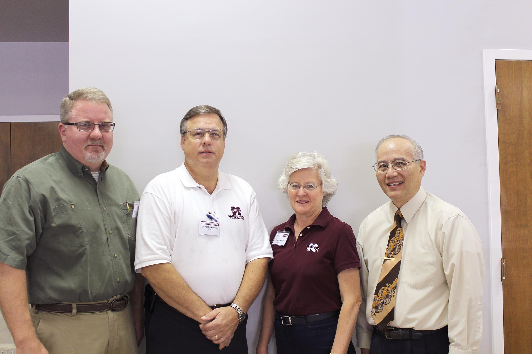 The Mississippi State University Extension Service hosted a workshop sponsored by the U.S. Department of Agriculture's Food Safety Inspection Service to help meat processors develop a food defense plan. Presenters included, from left, Dr. William Pepper, USDA-FSIS; Byron Williams and Anna Hood, MSU Extension Service; and Sam Chang, MSU Department of Food Science, Nutrition and Health Promotion. (MSU Ag Communications/Keri Collins Lewis)