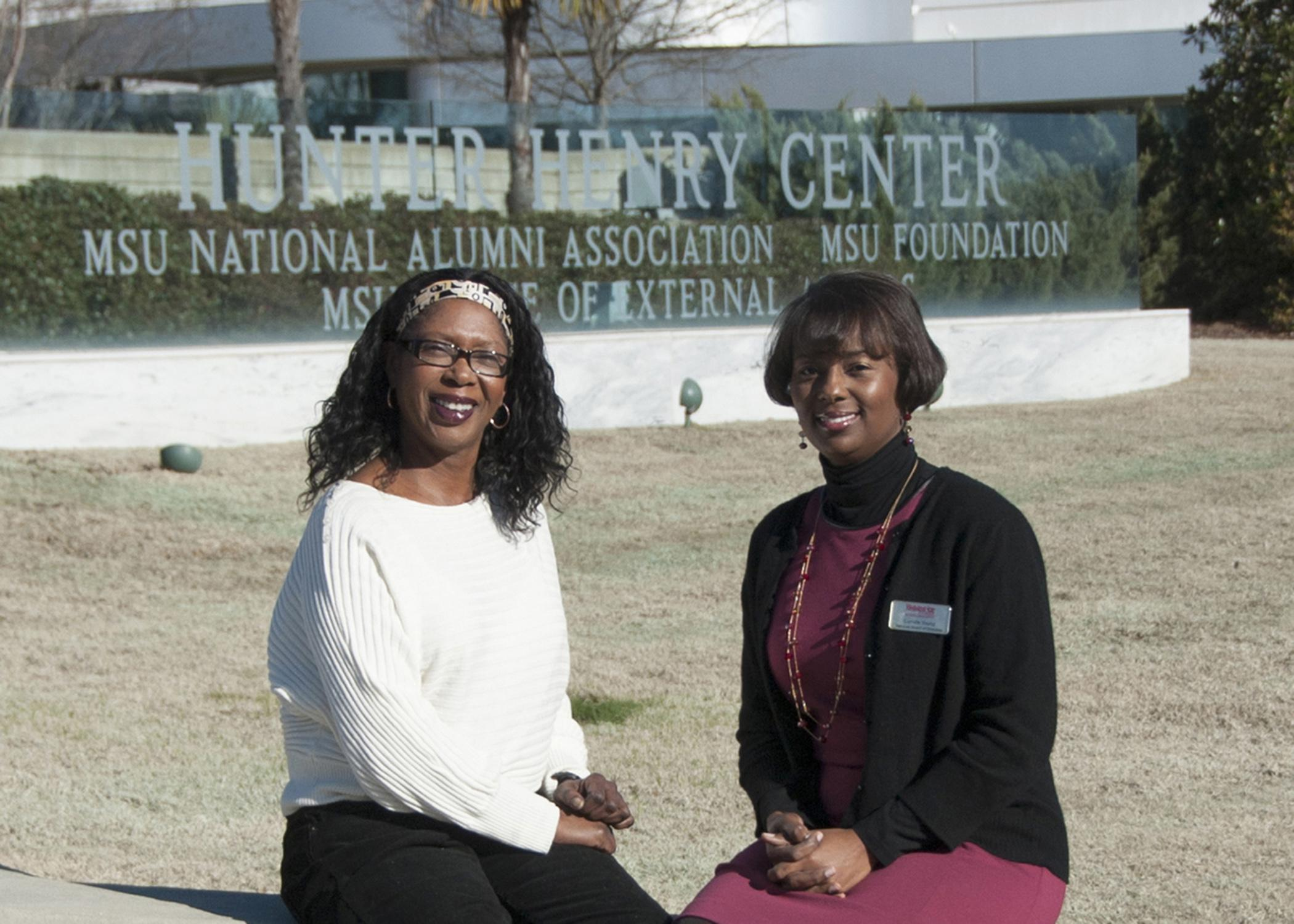 Paula Threadgill, associate director of the Mississippi State University Extension Service, left, and MSU Alumni Association National President Camille Scales Young take time to catch up on 4-H activities during a break in meetings on campus Feb. 1. Threadgill provides leadership for the Mississippi 4-H program, and Young serves on the 4-H Foundation Board of Trustees. (Photo by MSU Ag Communications/Kat Lawrence)