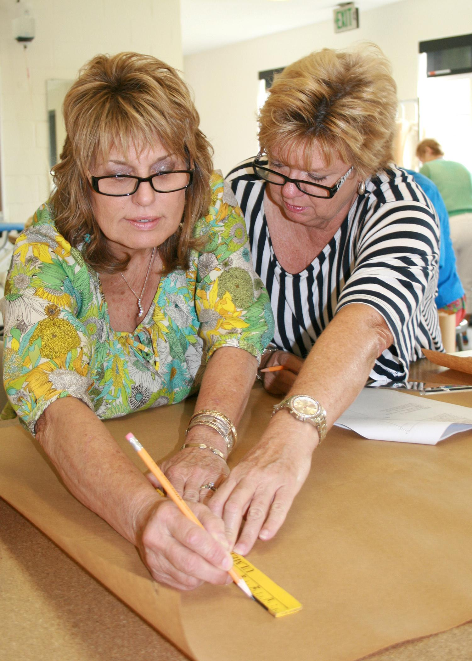From left, Ramona Edge, Itawamba County Extension coordinator, and Shelaine Pennington, Prentiss County Extension coordinator, learn how to make a flat pattern Aug. 1 during the annual Master Clothing Volunteers conference at Mississippi State University. (Photo by MSU Extension Center for Technology Outreach/Mariah Smith)