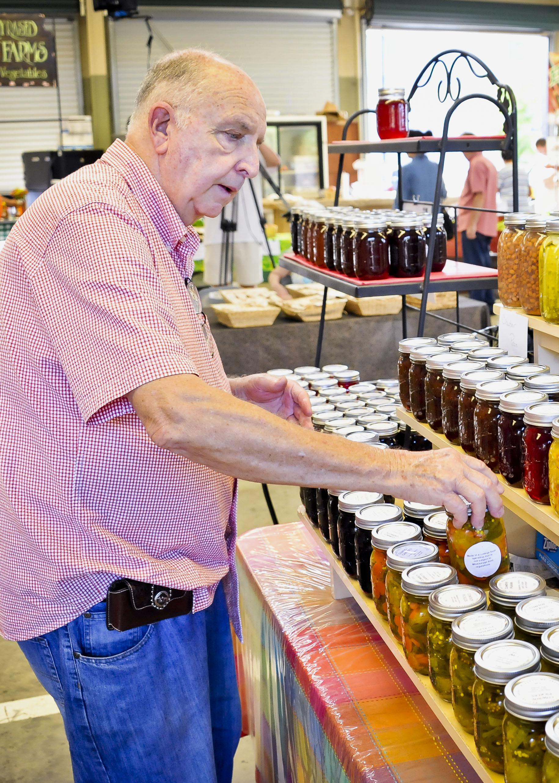 Claude Jones of Brandon sells canned and baked goods at the Mississippi Farmers Market in Jackson made in his home-based business, Old Fashioned Taste. (Photo by MSU Ag Communications/Scott Corey)