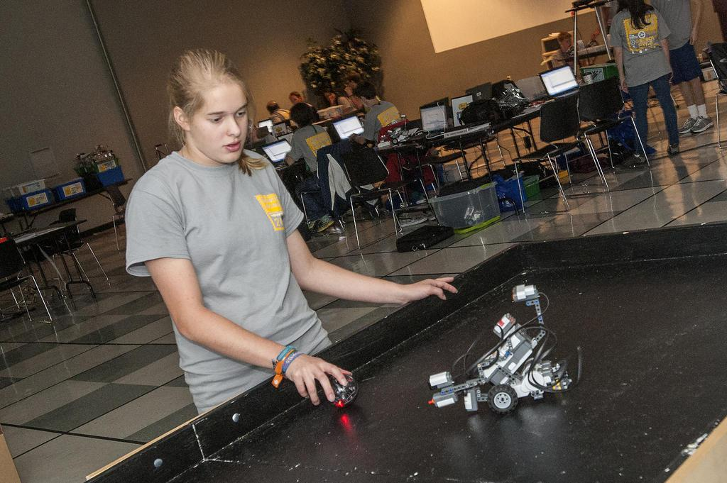 Renee Anderson, a member of a DeSoto County 4-H robotics club, prepares to test her robot's ability to chase an infrared ball, a task she programmed it to do. She took part in a five-day 4-H Robotics Academy hosted by the Mississippi State University Extension Service's Center for Technology Outreach. (Photo by MSU Ag Communications/Scott Corey)