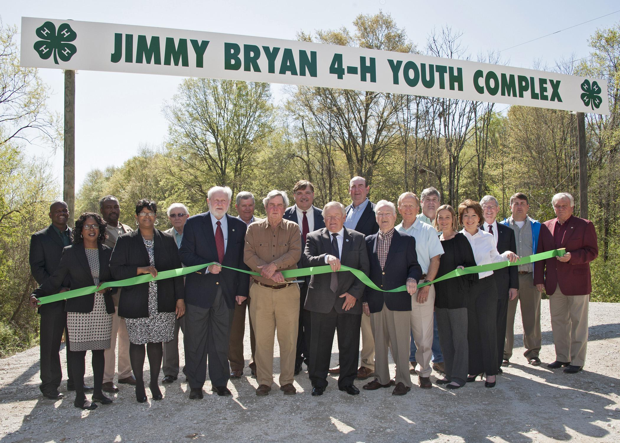 Mississippi State University Extension Service 4-H representatives, state and local officials, and industry representatives enjoy a beautiful day for a ribbon-cutting ceremony for the Jimmy Bryan 4-H Youth Complex in West Point April 10, 2014. Participants include Paula Threadgill, (front row, left), Angela Turner-James, Hobson Waits, Jimmy Bryan, Floyd McKee, Barney Jacks, Robbie Robinson, Paige Lamkin and Amy Berry; Lynn Horton (back row, left), Shelton Deanes, Preston Sullivan, Russell Jolly, Gary Jackso