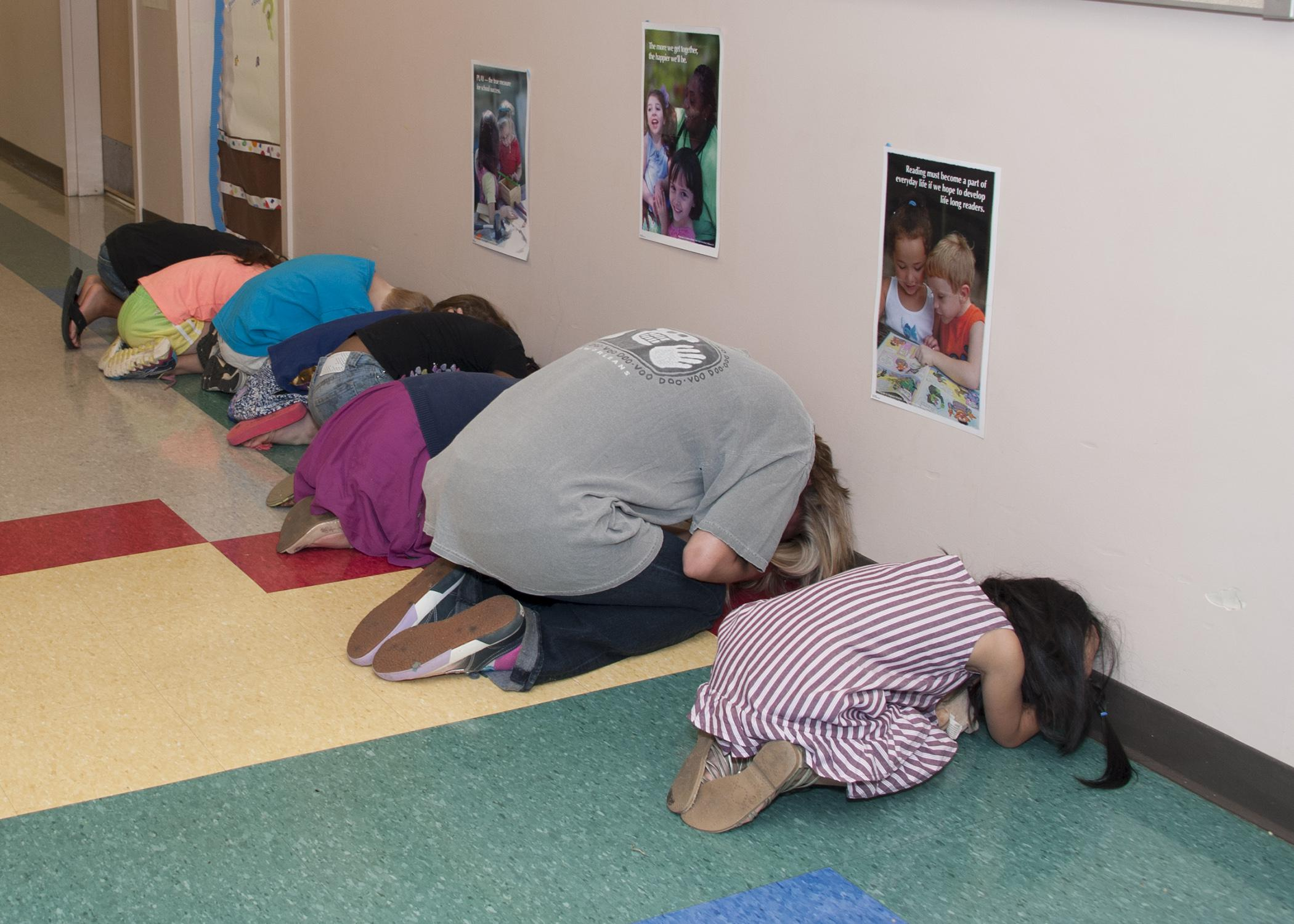 Preschoolers and workers practice together during a tornado drill at the Mississippi State University Child Development and Family Studies Center on July 16, 2014. (Photo by MSU Ag Communications/Kat Lawrence)