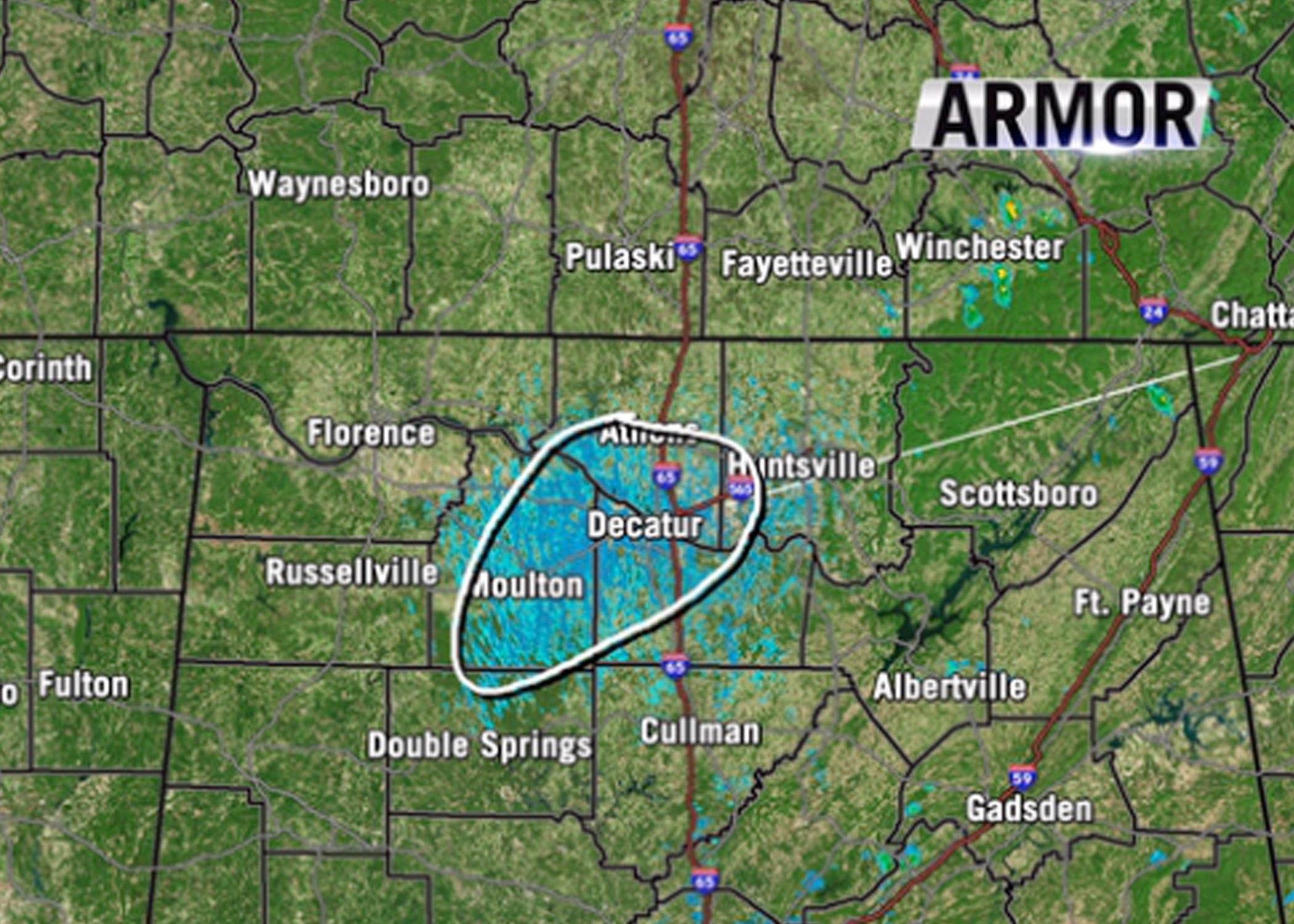 The blue mass circled over a map of Alabama indicates a high concentration of mayflies that swarmed Sept. 4, 2014, and were caught on weather radar. (Submitted Photo by WHNT/Jason Simpson)