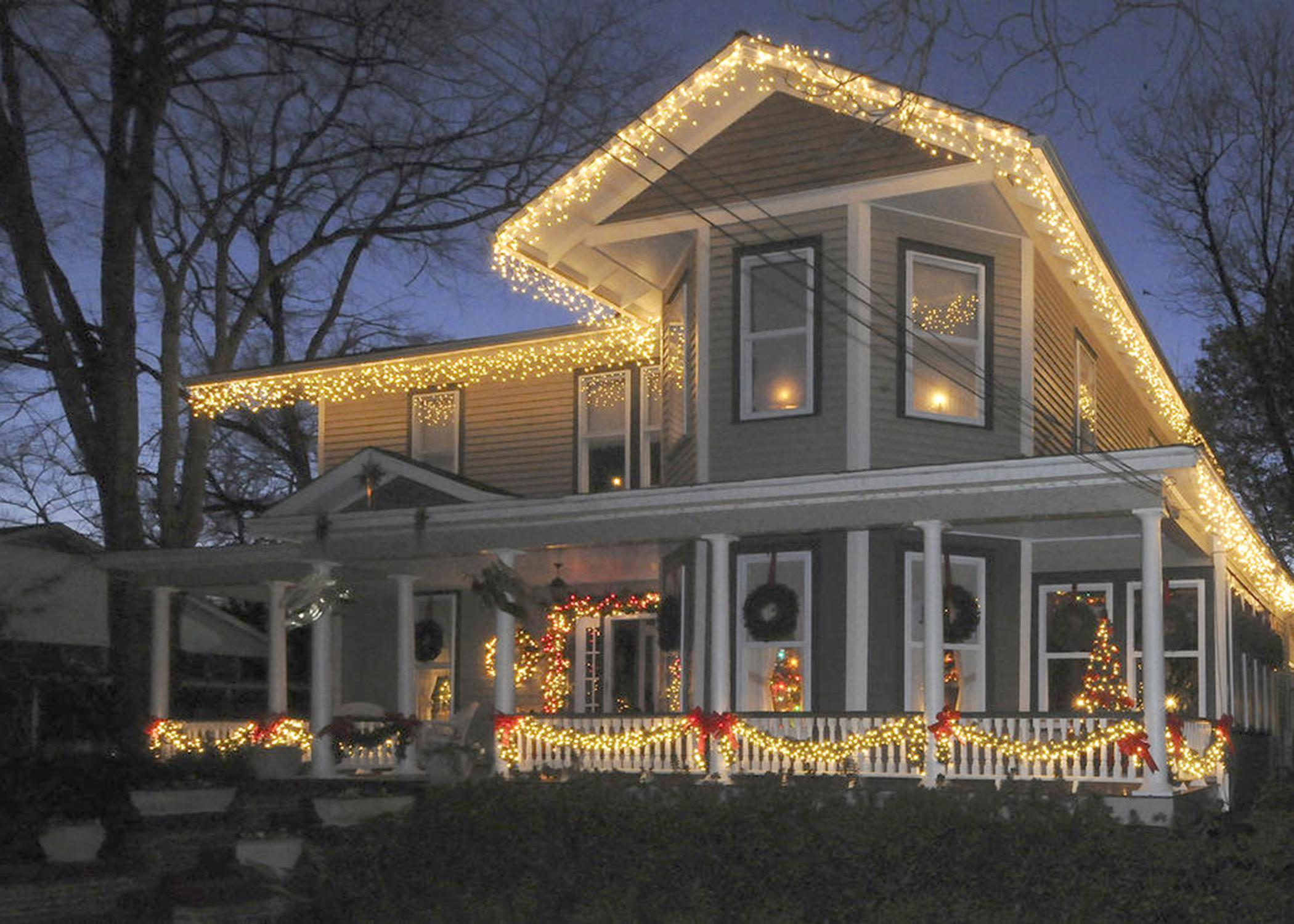Outdoor decorations, such as these on a Starkville home, brighten the holidays but should be unplugged at night for safety. (File photo by MSU Ag Communications/Scott Corey)