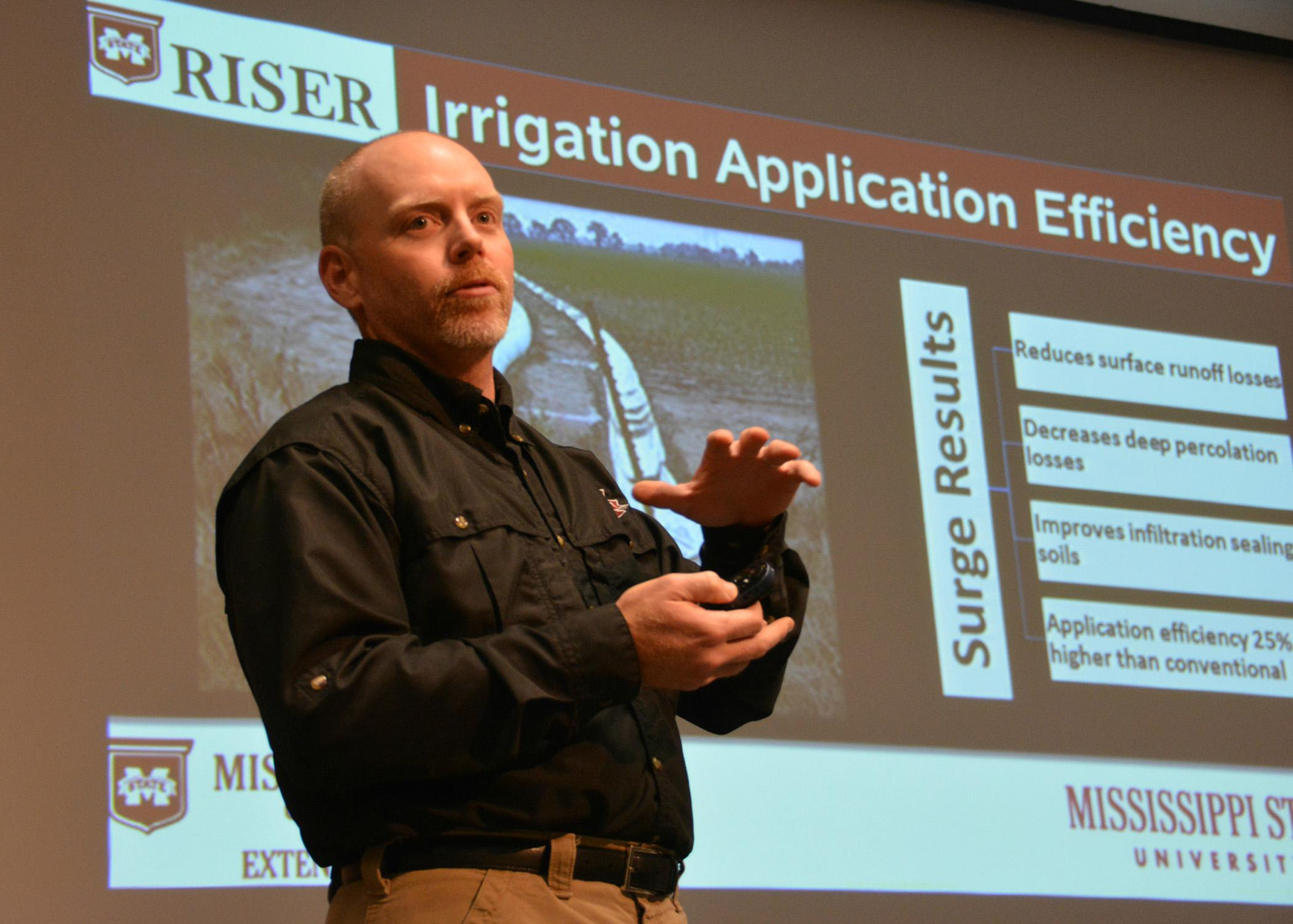 Jason Krutz, irrigation specialist with the Mississippi State University Extension Service, addresses water efficiency on cropland during the Mississippi Delta Irrigation Summit in Stoneville, Mississippi, on Dec. 10, 2014. (Photo by MSU Ag Communications/Linda Breazeale)