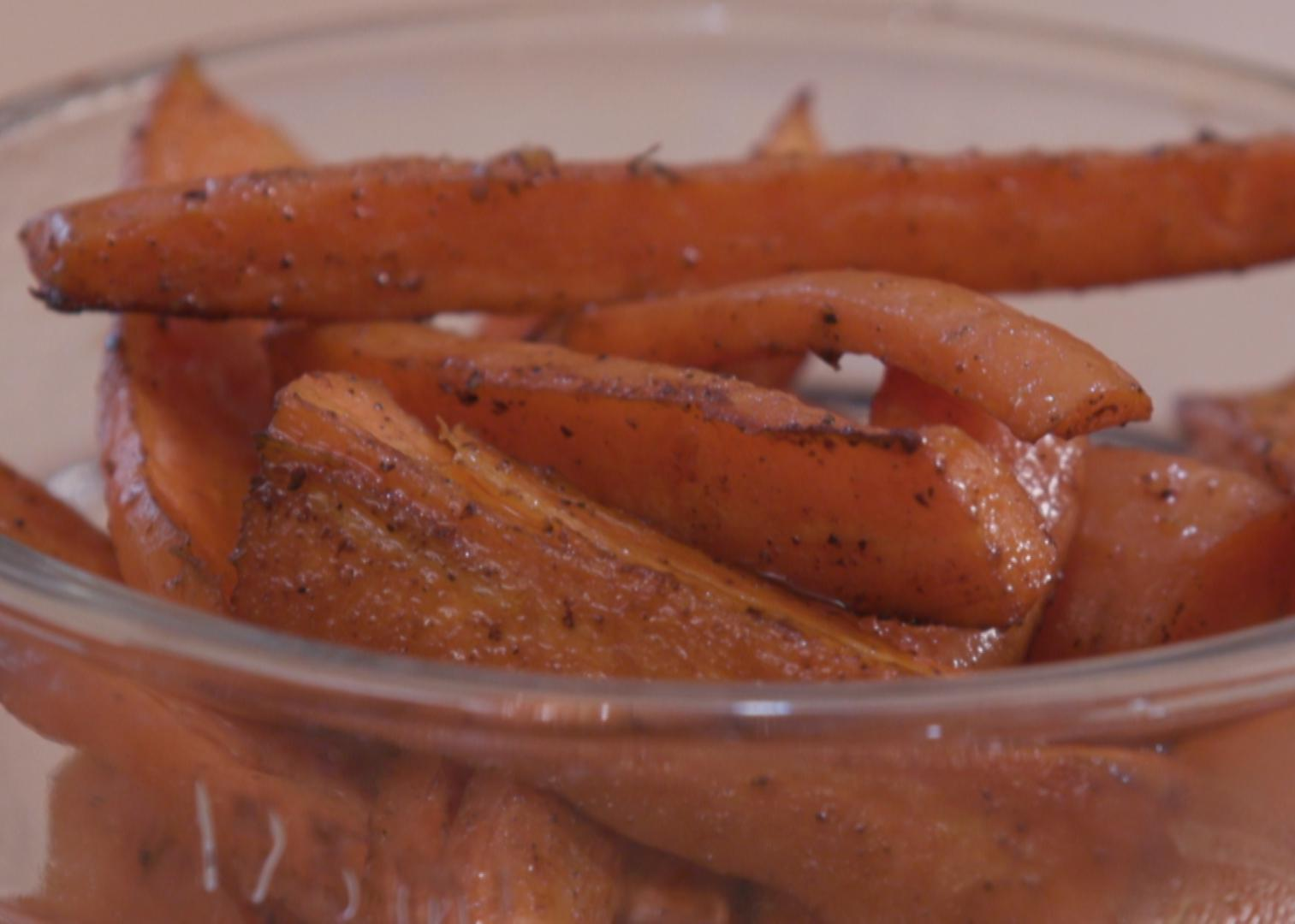 Oven-roasted carrots in a clear glass bowl