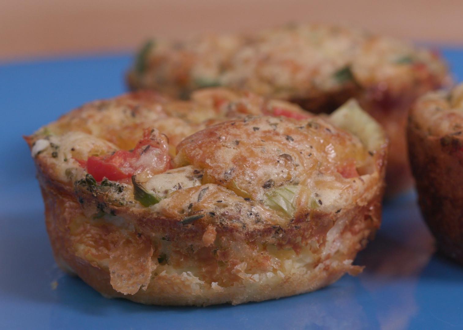 Veggie quiche muffins on a blue plate