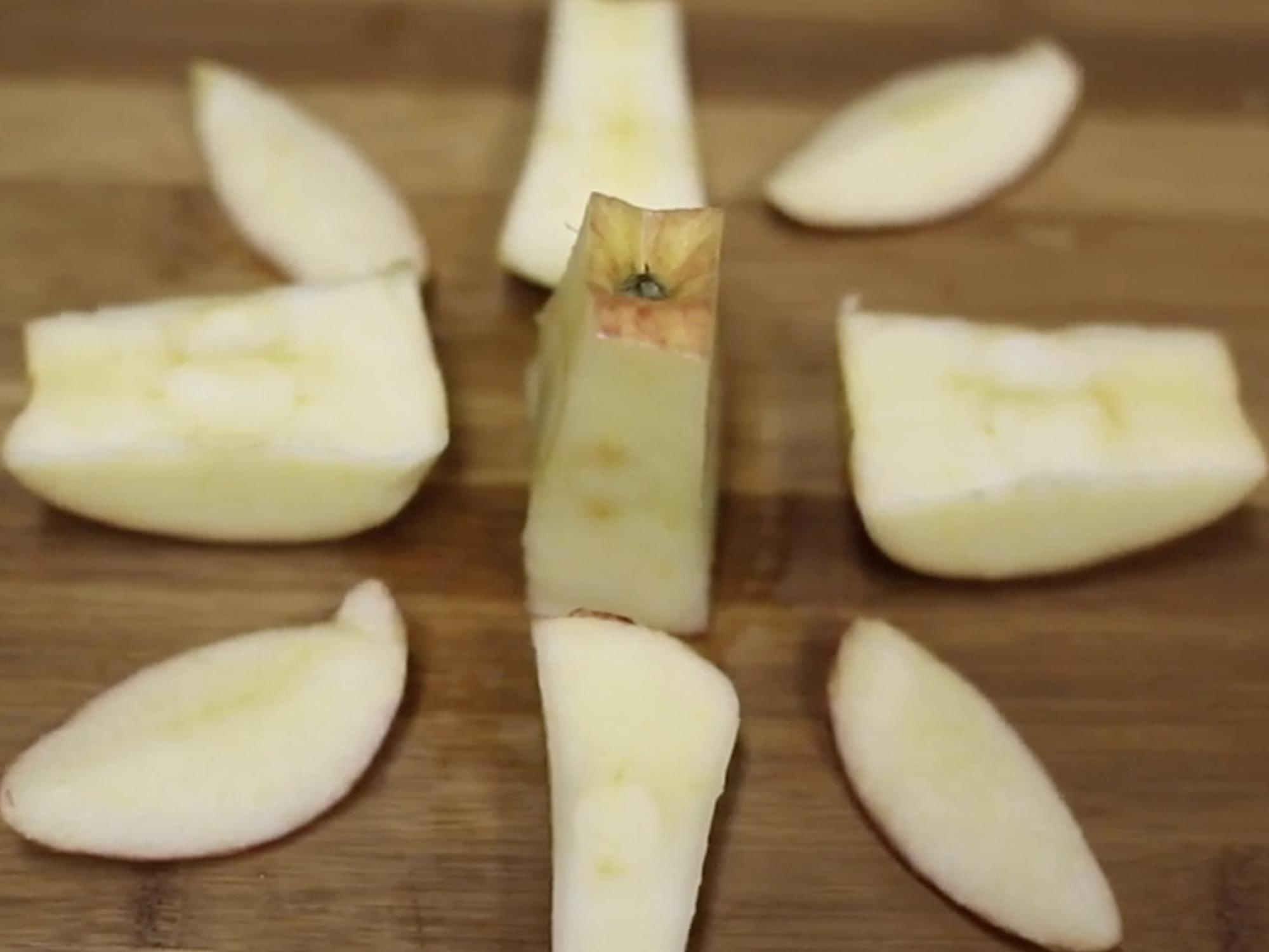 apple slices on cutting board.