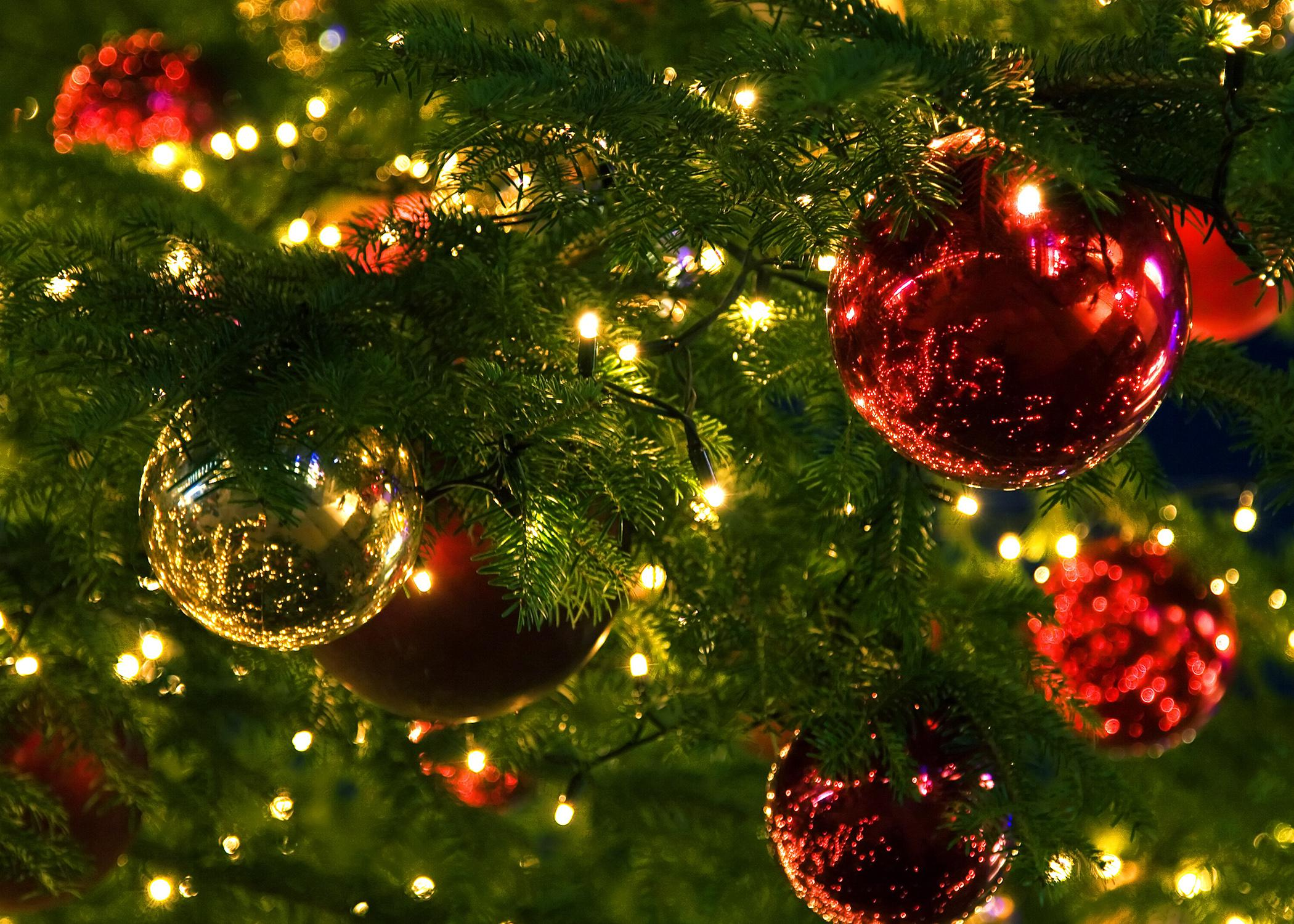 Closeup of ornaments and lights on a Christmas tree