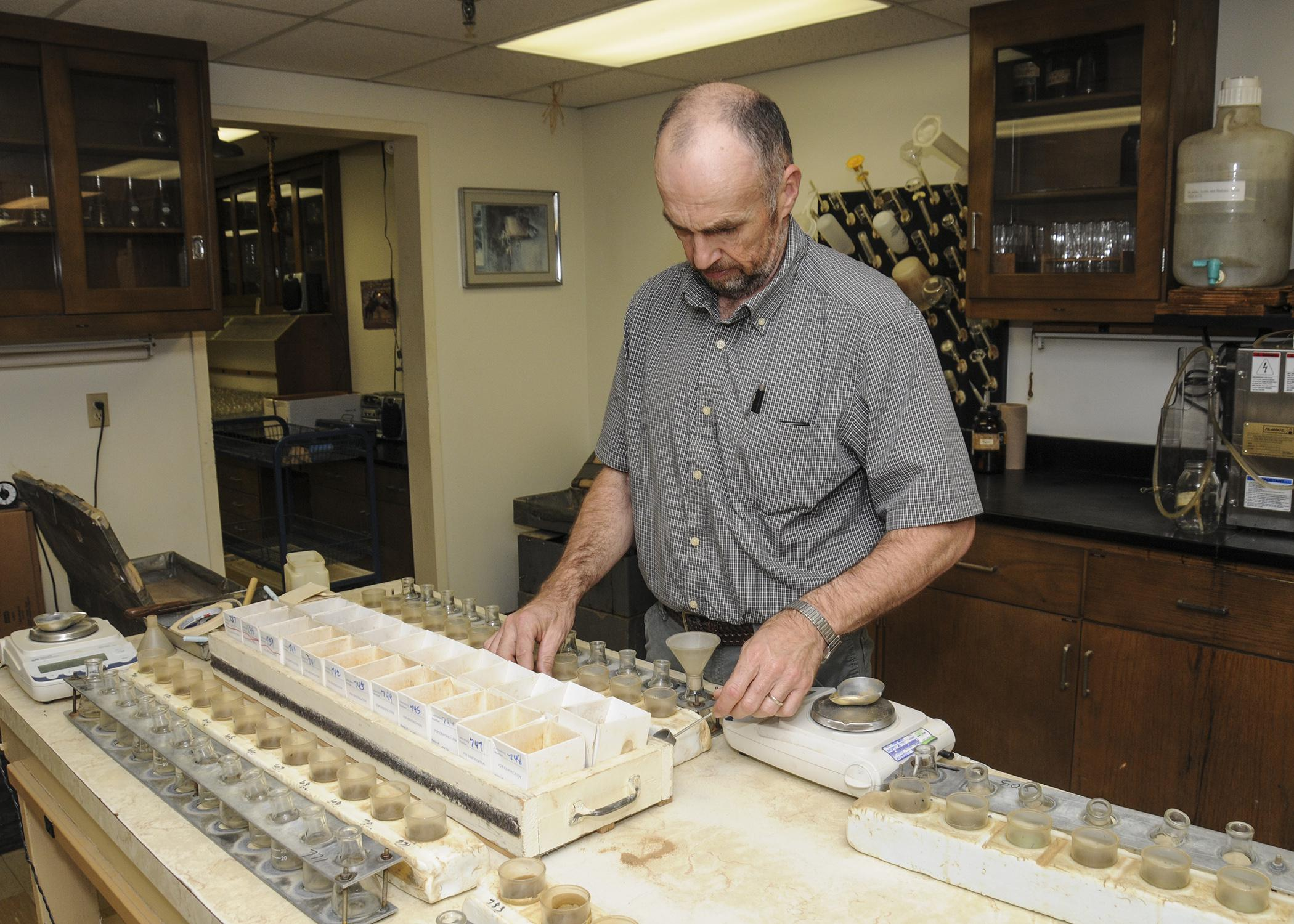 Mississippi State University Extension Service agronomy specialist Keith Crouse sorts through routine samples on April 10, 2013, in the MSU Soil Testing and Plant Analysis Lab, where every day is Earth Day, not just April 22. (Photo by MSU Ag Communications/Scott Corey)