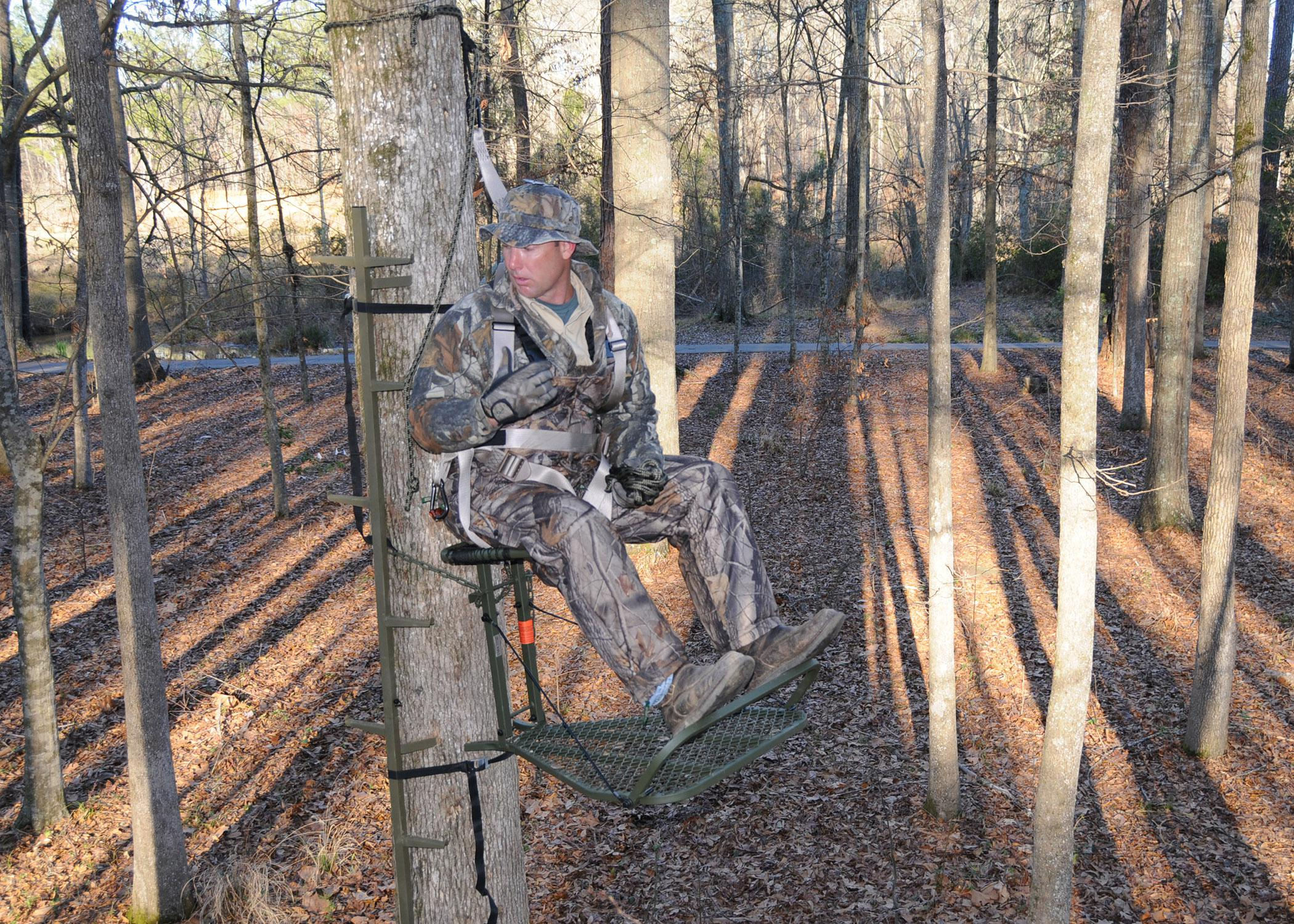John Louk with the Treestand Manufacturer's Association demonstrates a properly secured safety harness when using a portable, lock-on tree stand. (File photo courtesy of the Treestand Manufacturer's Association)