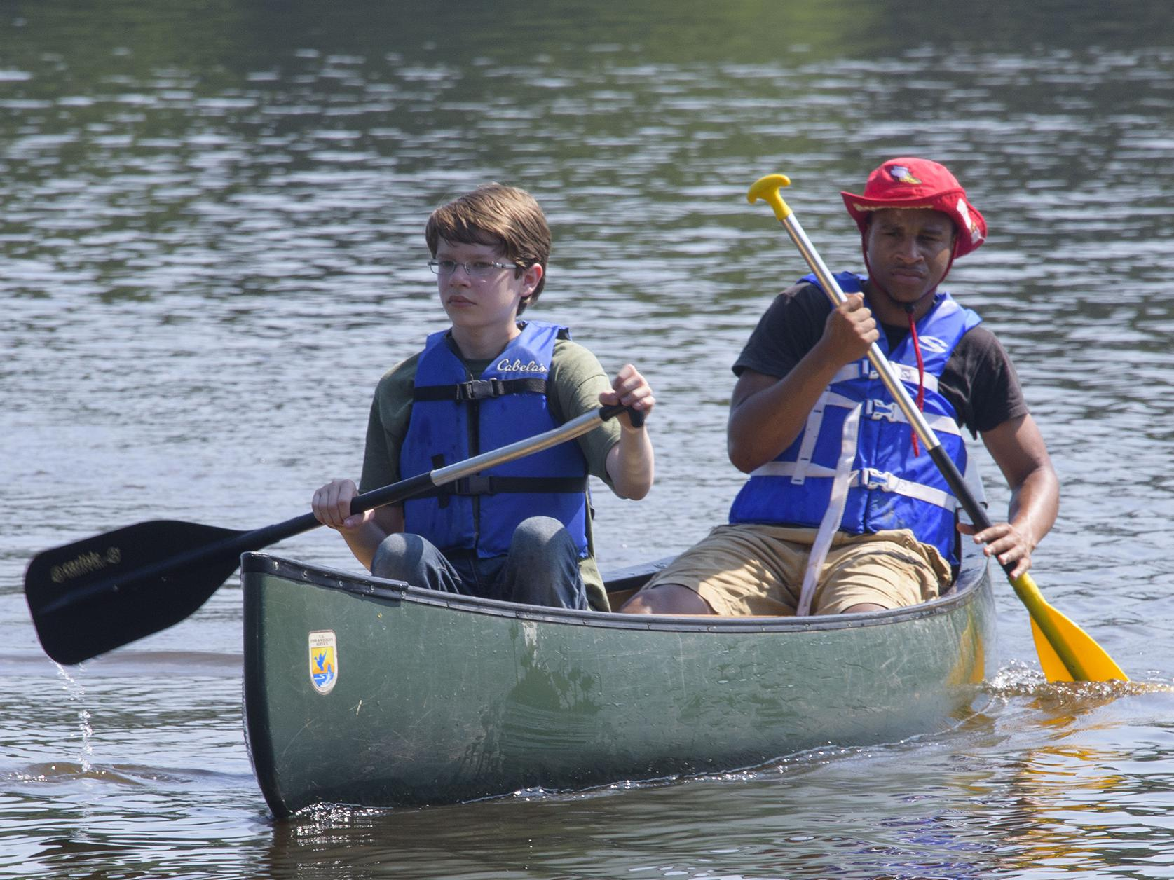 Young campers paddle across a lake during a Mississippi State University conservation camp in 2015. (Photo by MSU Extension Service/Kevin Hudson)