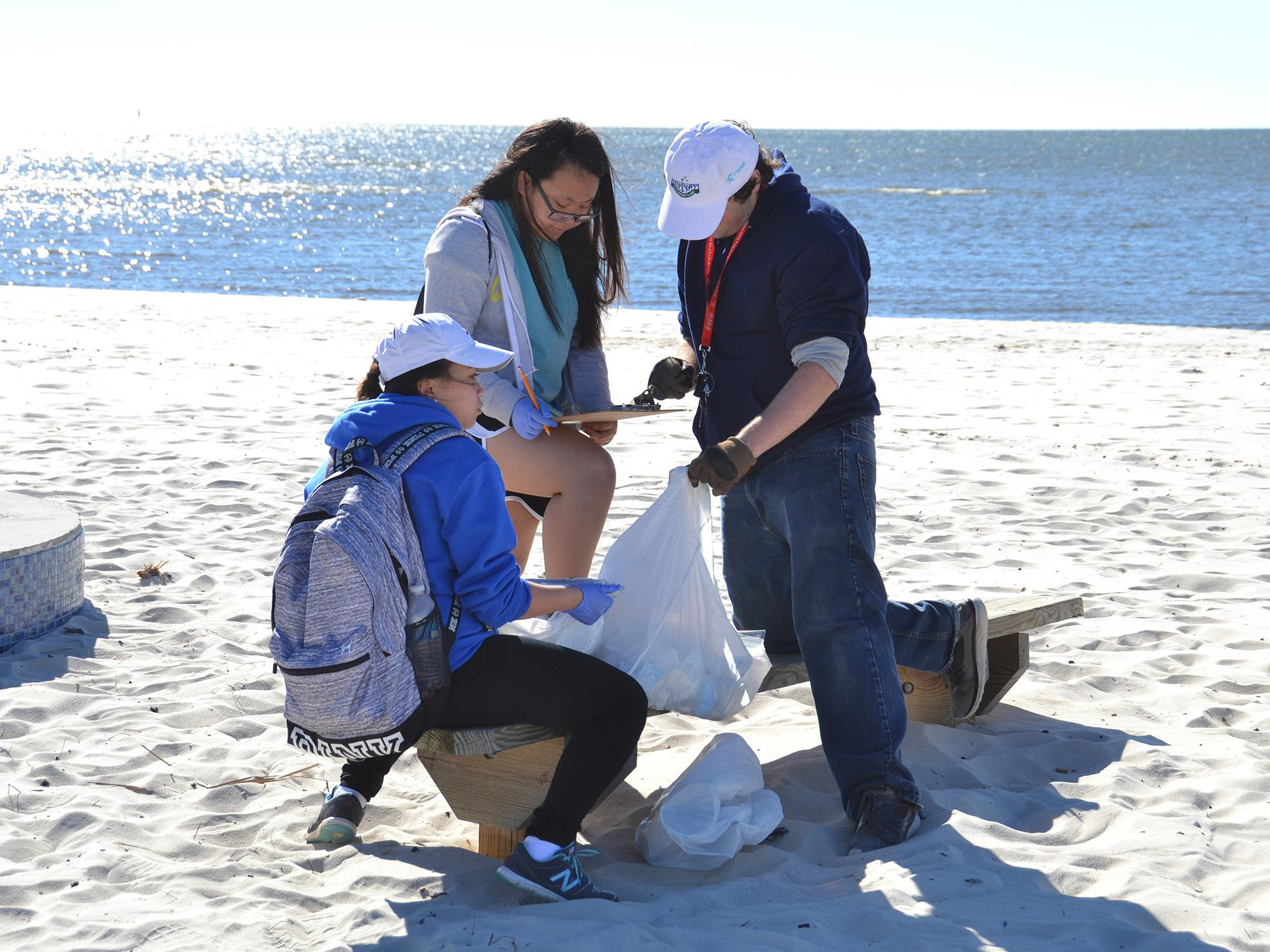 Volunteers record the types of trash they collected during a recent Mississippi Coastal Cleanup in Biloxi, Mississippi.