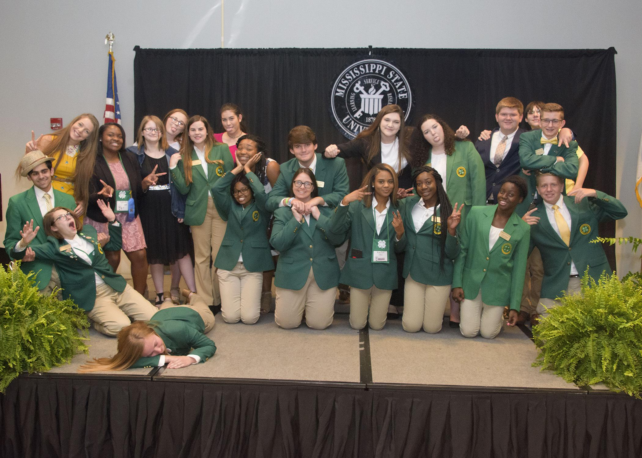 A group of 4-H'ers make silly gestures.