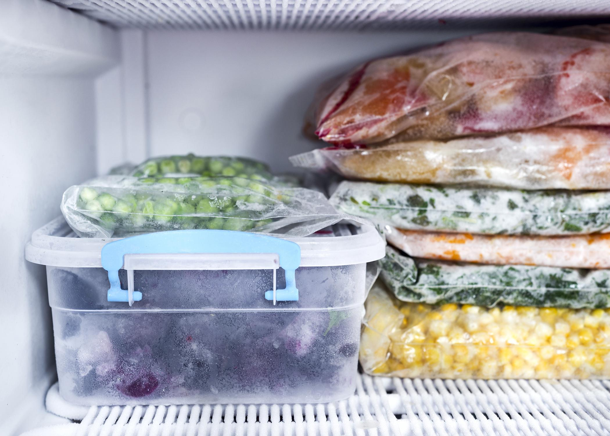 Frozen foods sit in the freezer.