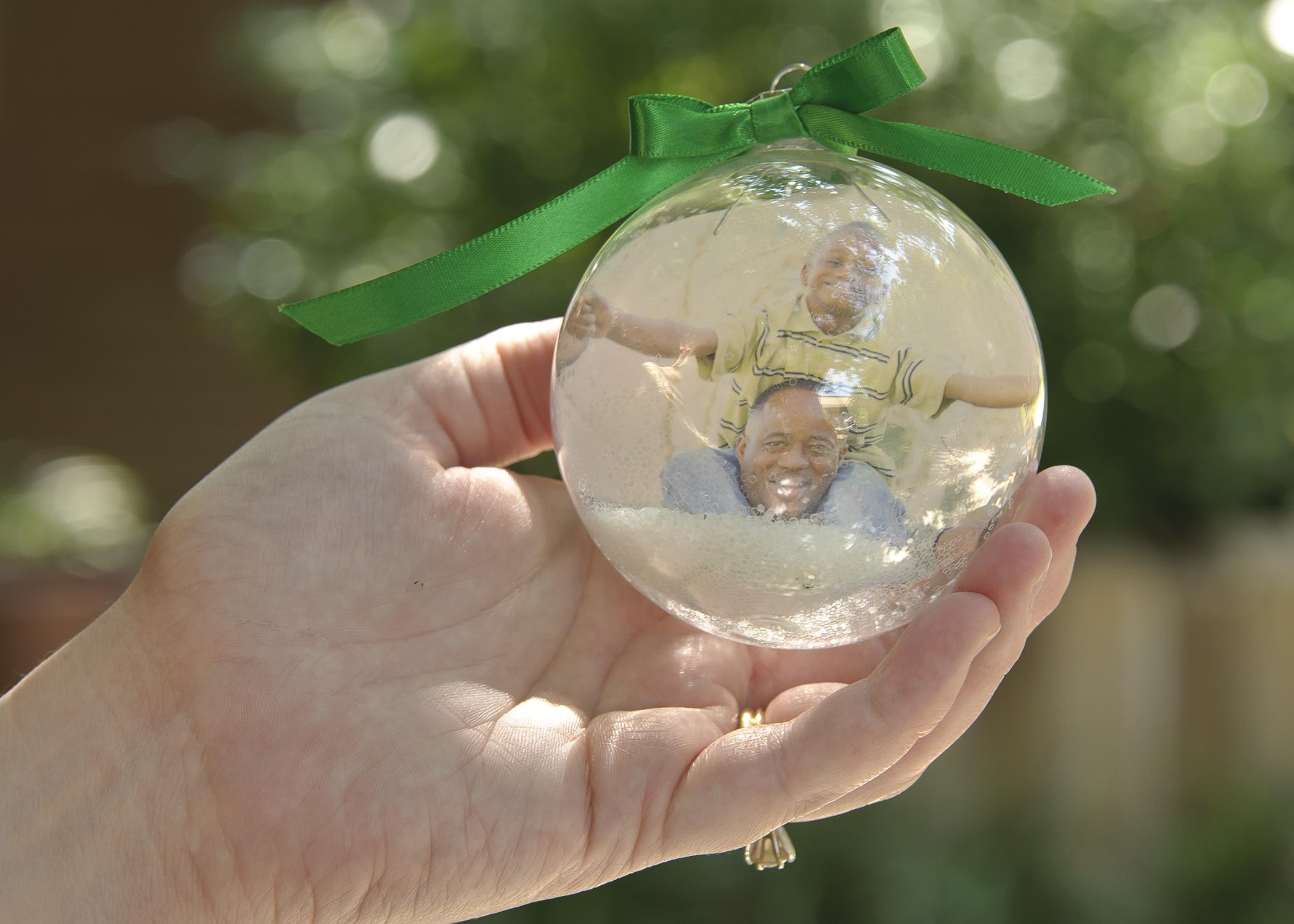 Use a clear glass ornament and a digital photo to create a simple and personal Christmas present that will impress family and friends. (Photo by MSU Ag Communications/Kevin Hudson)