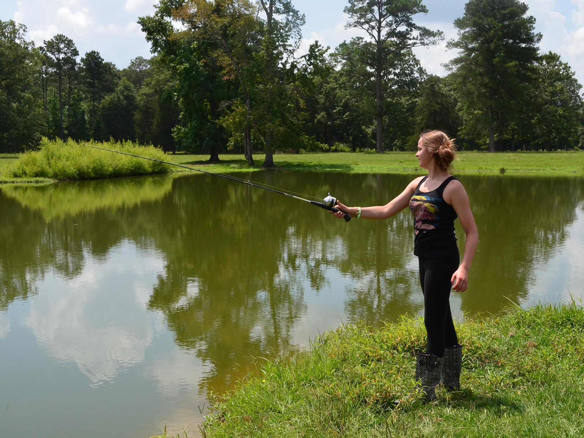 This young angler is actually helping an Oktibbeha County pond grow larger fish. Pond and lake managers need to harvest 1 pound of bass to 5 pounds of bream, usually beginning in the third year after stocking, to promote larger fish. (MSU Extension Service file photo/Linda Breazeale)