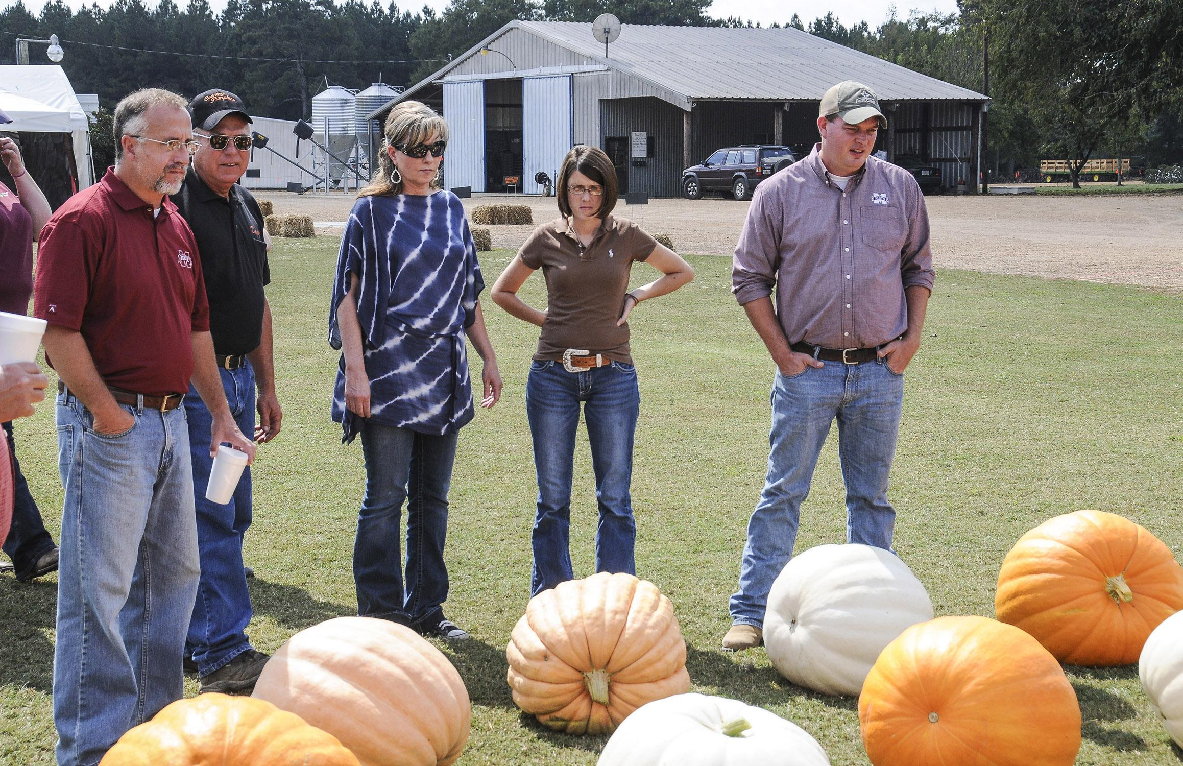 Extension agricultural agents review pumpkins recently harvested at County Pumpkins in Lowndes County. The fall tour participants include, from left, Jeff Wilson of Lowndes County, farm owner Dwight Colson of Caledonia, Kimberly Wilborn of Lamar County, Julie White of Oktibbeha County and Reid Nevins of Lowndes County. (Photo by MSU Ag Communications/Scott Corey)