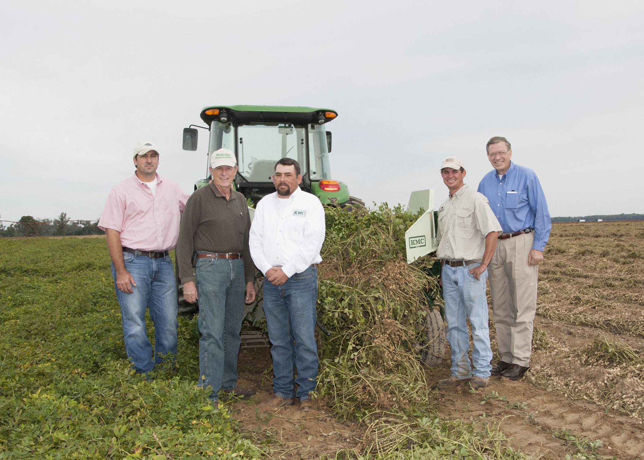A two-row digger shaker donated to the Mississippi Peanut Growers Association by Kelley Manufacturing Company was demonstrated recently at Parrish Farms in Holmes County. On hand for the demonstration were, from left, Brad Burgess, Mississippi State University's variety testing director; Malcolm Broome, Mississippi Peanut Growers Association executive director; Keith Weeks, KMC territory manager; Daniel Parrish, MPGA board member; and Reuben Moore, Mississippi Agricultural and Forestry Experiment Station as